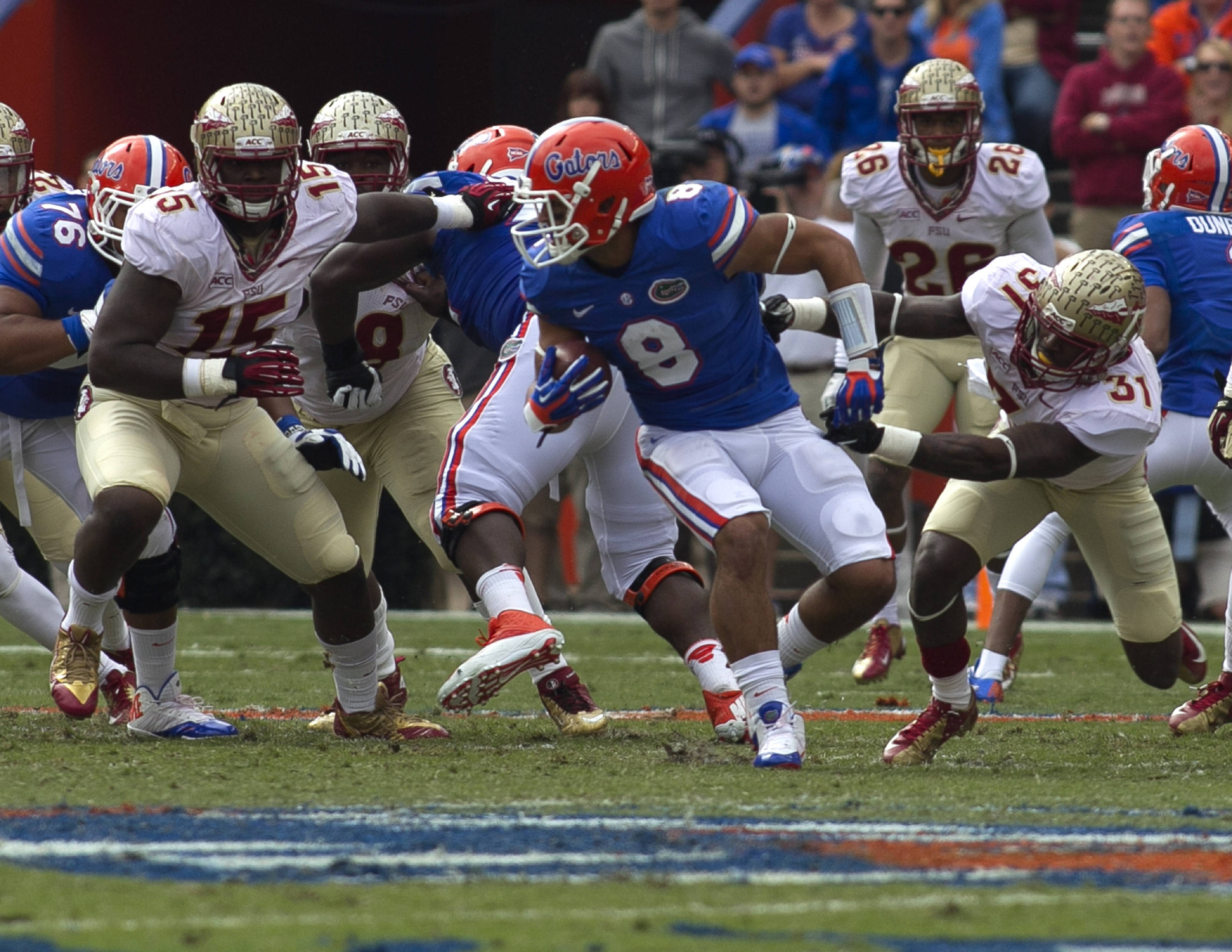 Terrance Brooks (31) with a tackle for a loss, FSU vs Florida, 11-30-13,  (Photo by Steve Musco)