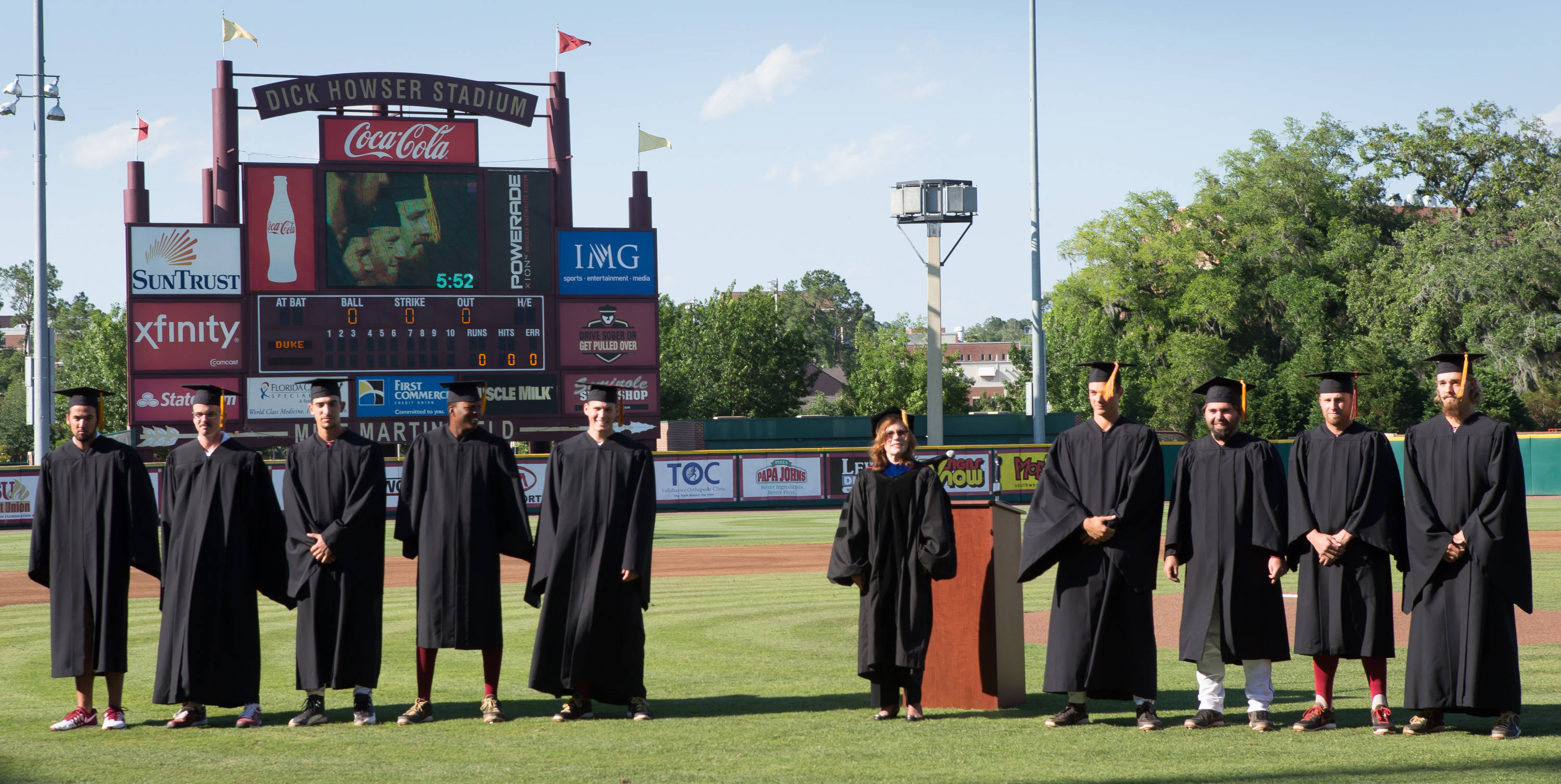 Graduating players and team managers receive their degrees from acting President Garnett Stokes.