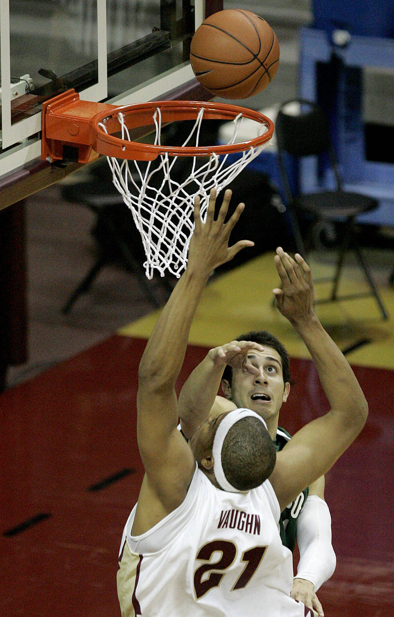 Stetson's Eric Diaz tries to stop Florida State's Julian Vaughn as he drives to the basket in the first half of a college basketball game on Friday Nov. 30, 2007 in Tallahassee, Fla. (AP Photo/Steve Cannon)