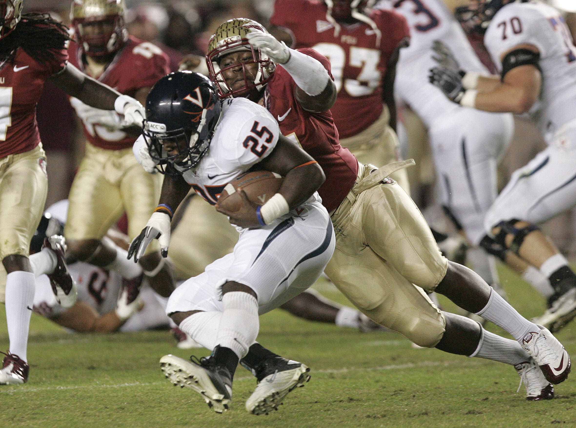 Florida State's Vince Williams tackles Virginia's Kevin Parks (25).(AP Photo/Steve Cannon)
