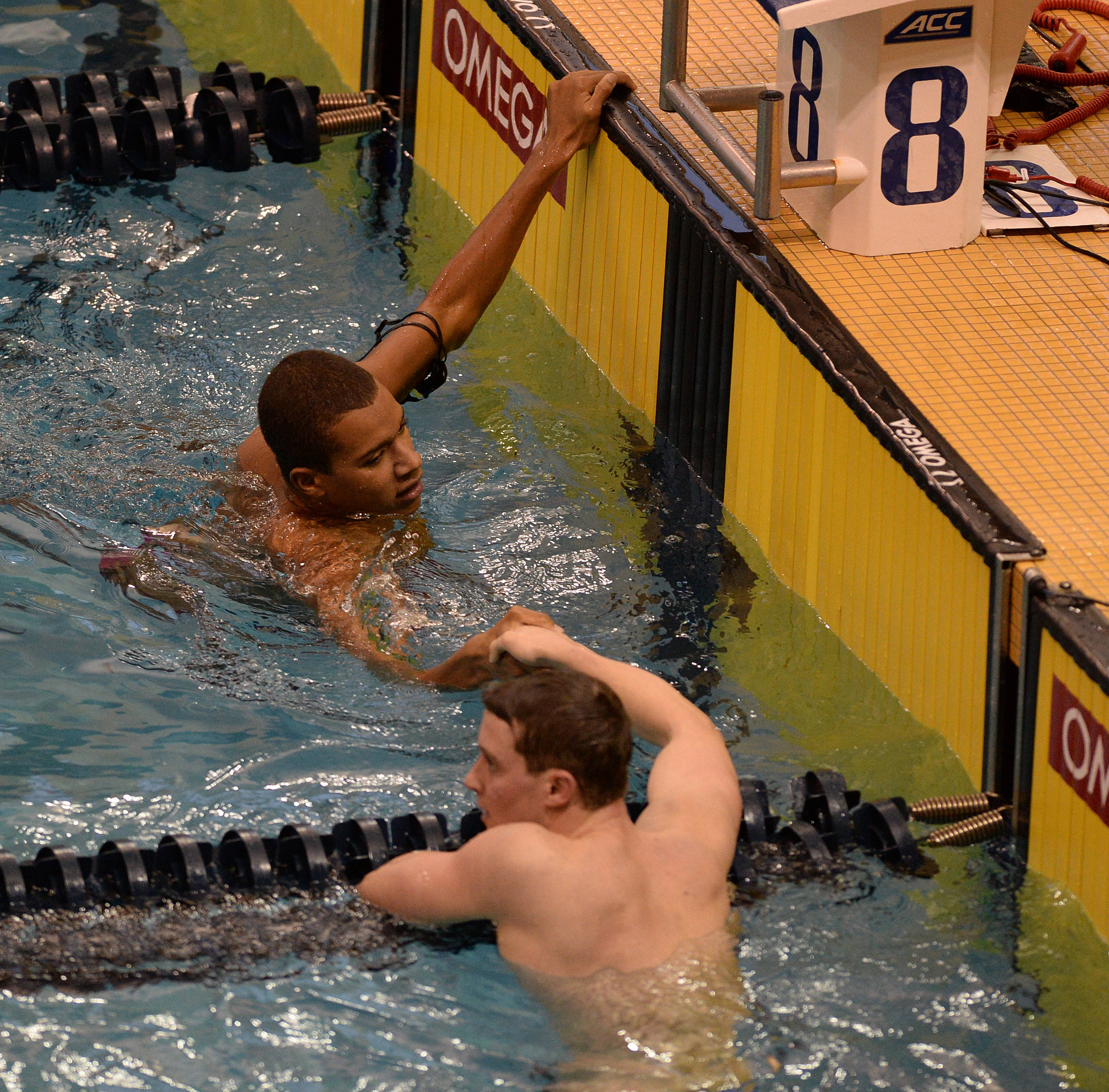 Calvin Bryant shakes hands after his 500 free - Mitch White