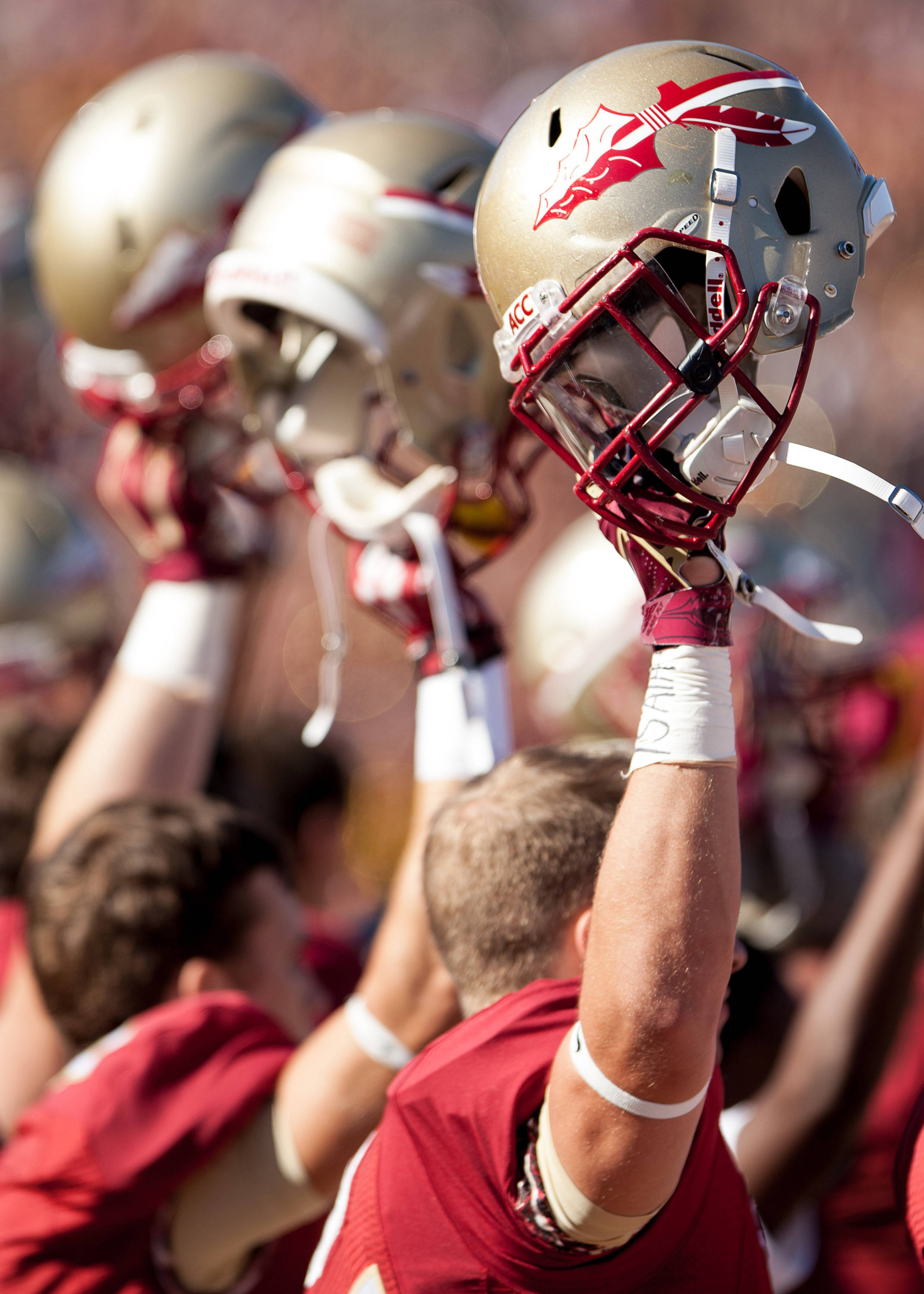 FSU players raise their helmets before FSU Football's 49-17 win over NC State on Saturday, October 26, 2013 in Tallahassee, Fla. Photo by Michael Schwarz.