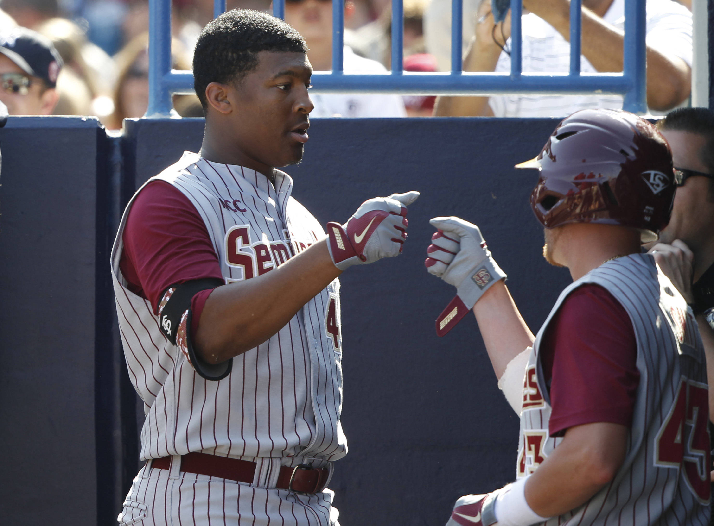 Feb 25, 2014; Tampa, FL, USA;  Florida State Seminoles pitcher/outfielder Jameis Winston (44) come back into the dugout after he batted during the sixth inning against the New York Yankees at George M. Steinbrenner Field. Mandatory Credit: Kim Klement-USA TODAY Sports