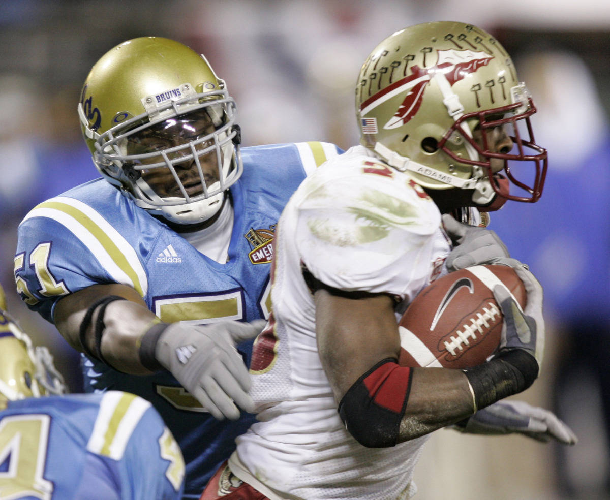 Running back Lorenzo Booker runs past UCLA's Reggie Carter (51) during the second half of the Emerald Bowl in San Francisco, Wednesday, Dec. 27, 2006. (AP Photo/Marcio Jose Sanchez)