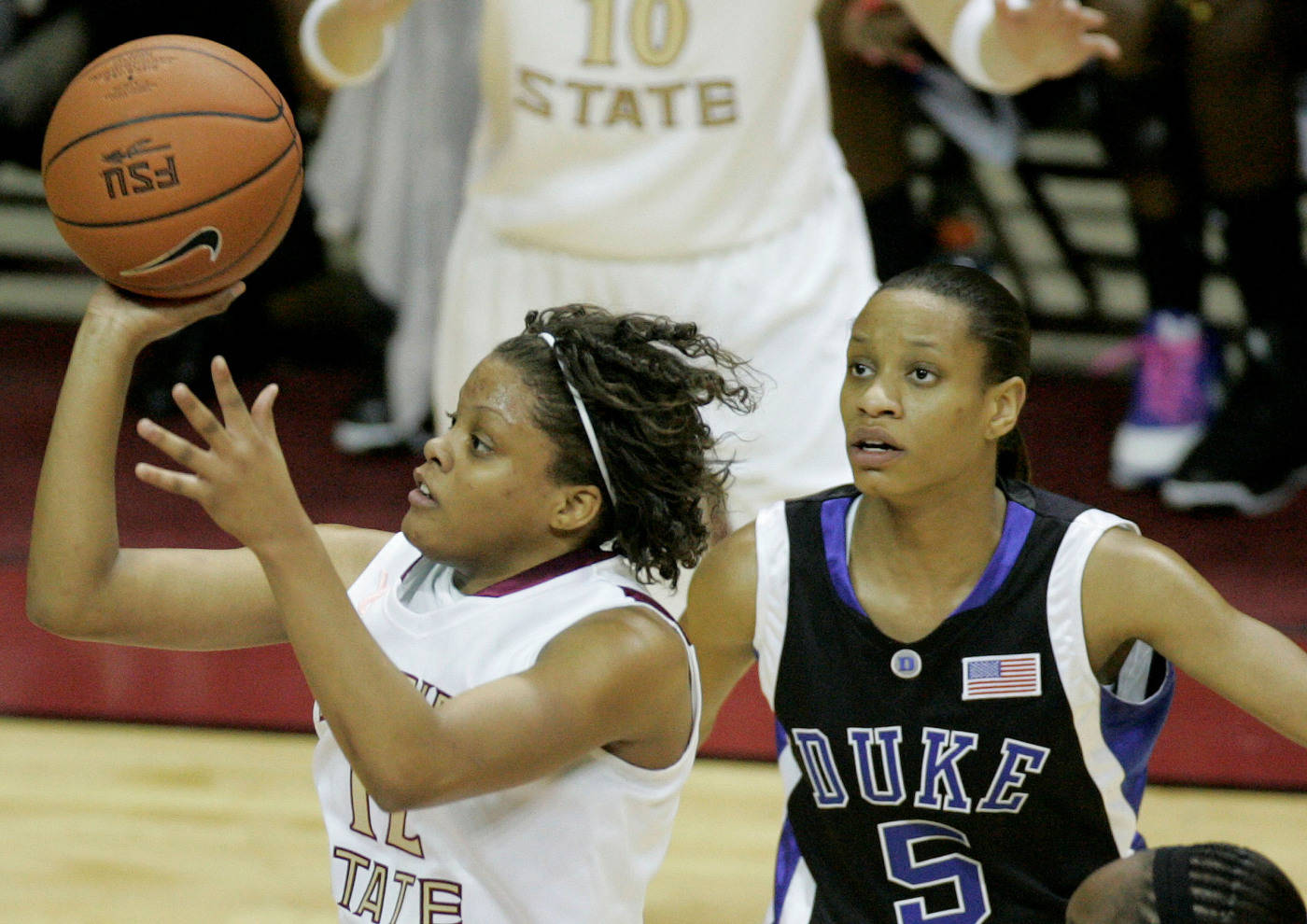 Florida State's Courtney Ward, left, shoots for two first-half points past Duke's Jasmine Thomas during an NCAA college basketball game, Thursday, Jan. 29, 2009, in Tallahassee, Fla.(AP Photo/Phil Coale)