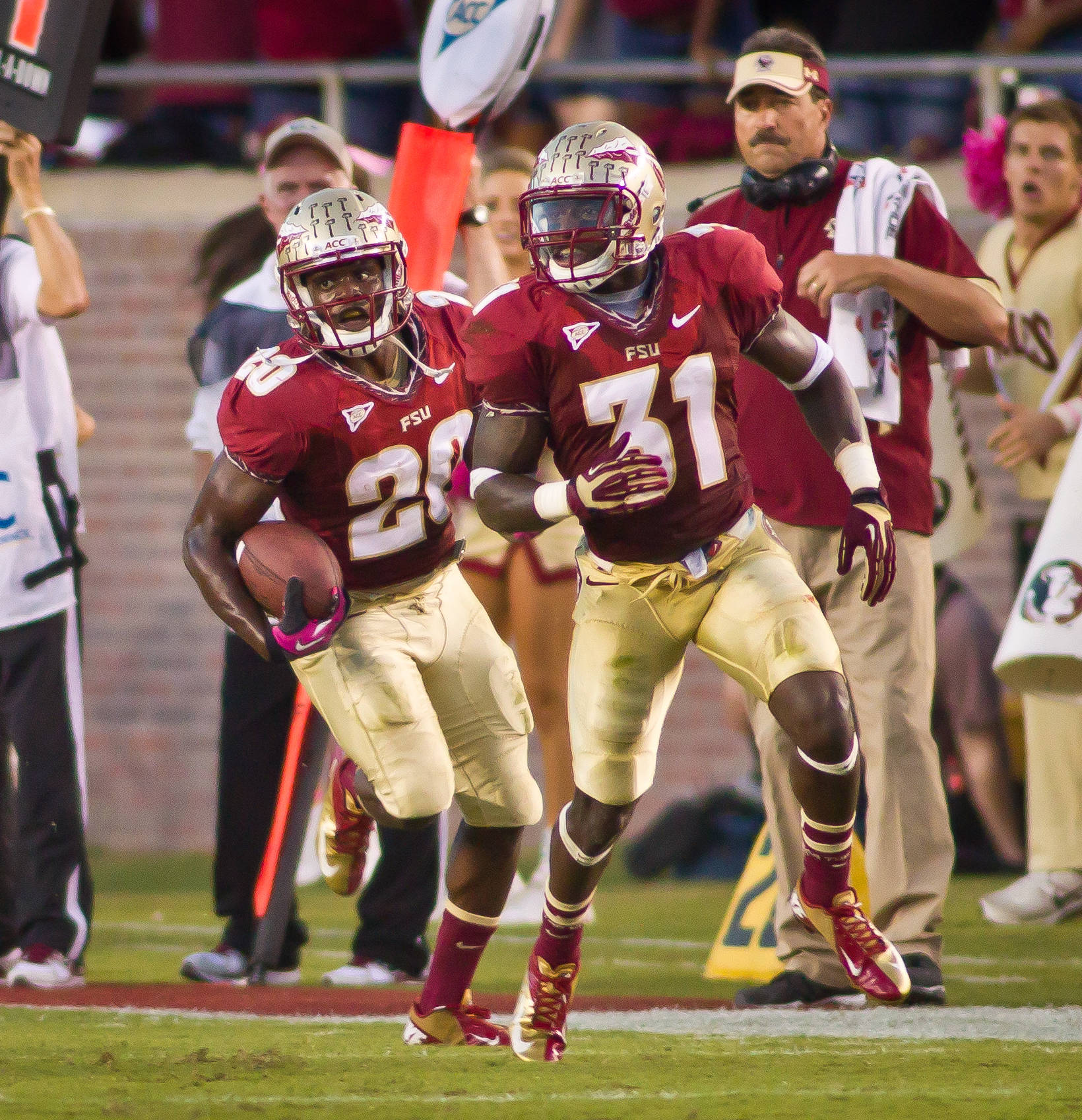 Lamarcus Joyner (20) returns a Boston College interception.