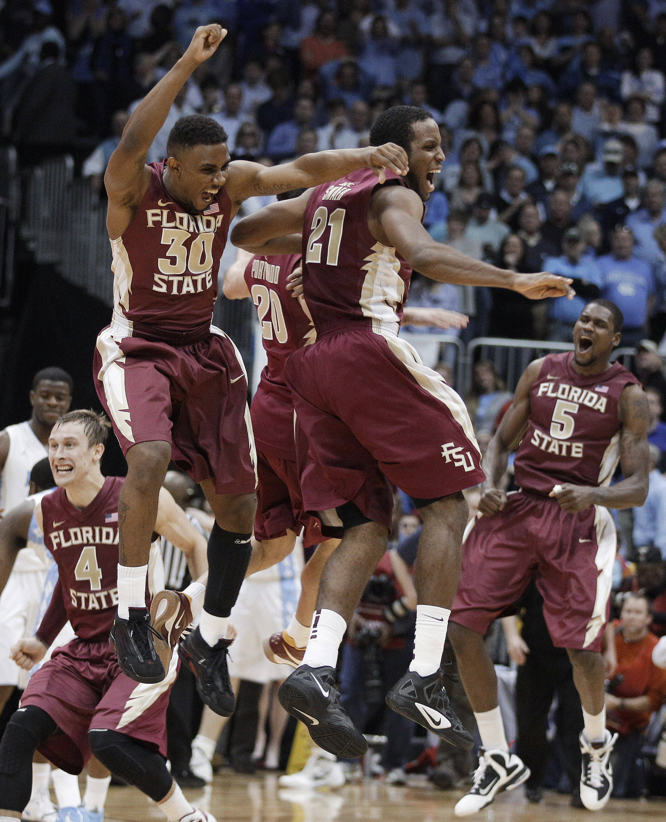 The Seminole team celebrates. (AP Photo/Chuck Burton)