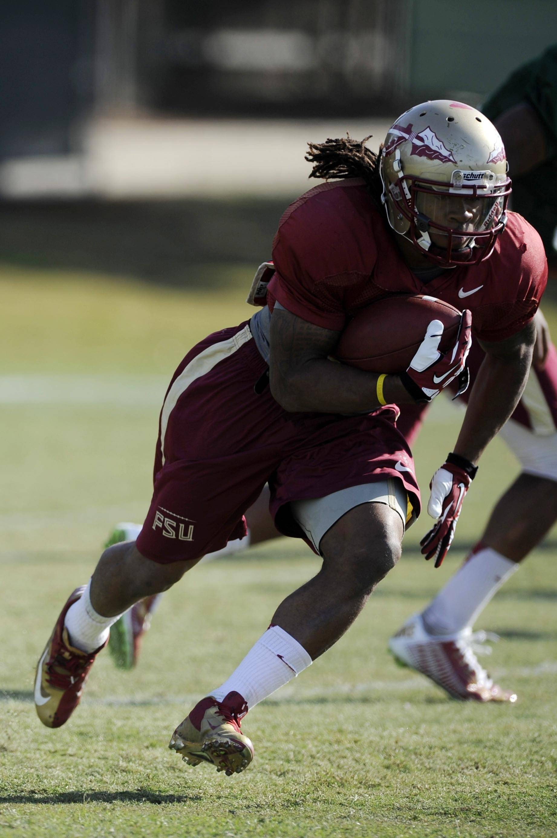 Jan 3, 2014; Orange, CA, USA; Florida State Seminoles running back Devonta Freeman (8) during practice for the BCS National Championship football game against the Auburn Tigers at Orange Coast College. Mandatory Credit: Kelvin Kuo-USA TODAY Sports