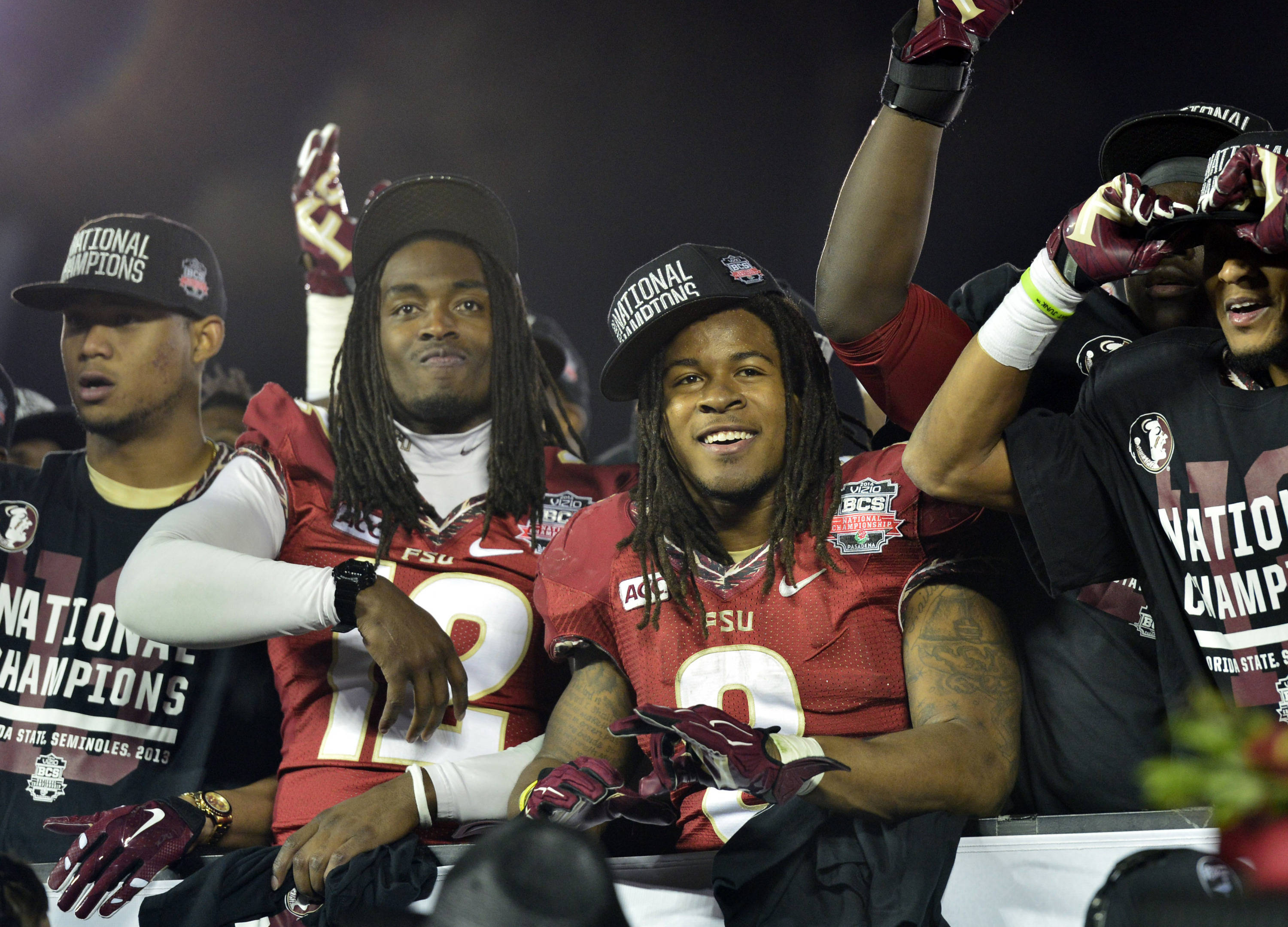 Jan 6, 2014; Pasadena, CA, USA; Florida State Seminoles quarterback Hunter Dewitt (12) and running back Devonta Freeman (8) celebrate after winning the 2014 BCS National Championship game against Auburn Tigers 34-31 at the Rose Bowl.  Mandatory Credit: Richard Mackson-USA TODAY Sports