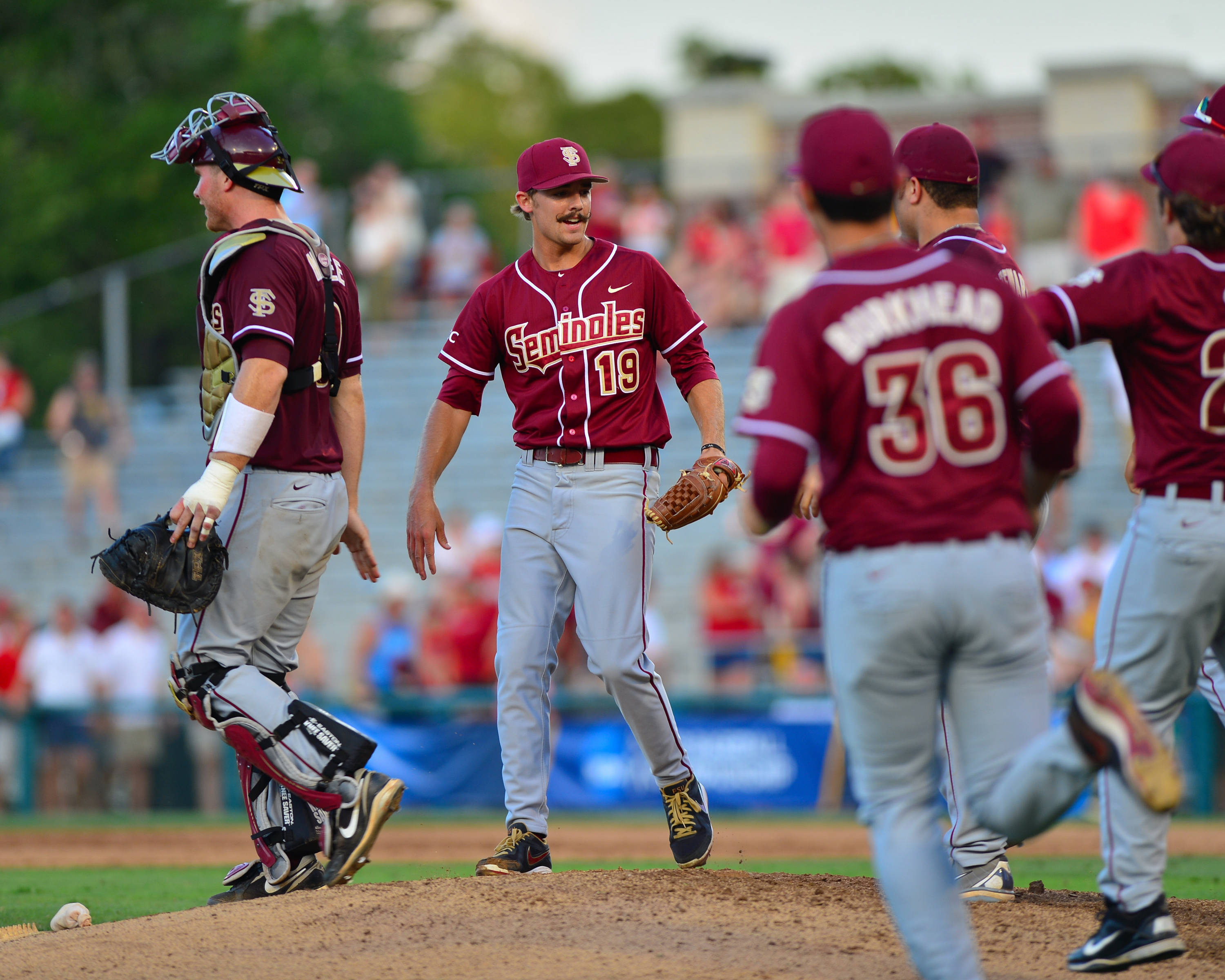 The Seminoles celebrate on the mound following Saturday's victory over Troy.