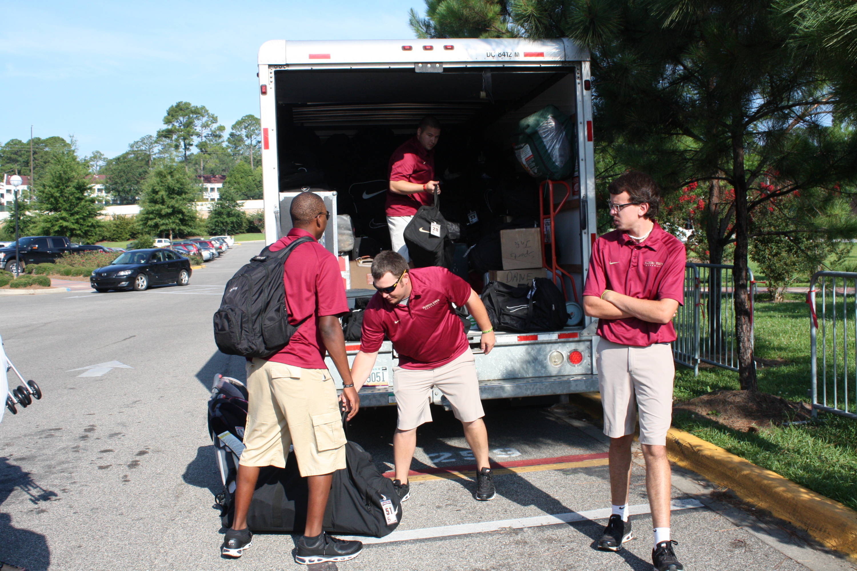 The baseball equipment staff loading the truck for the trip to Omaha.