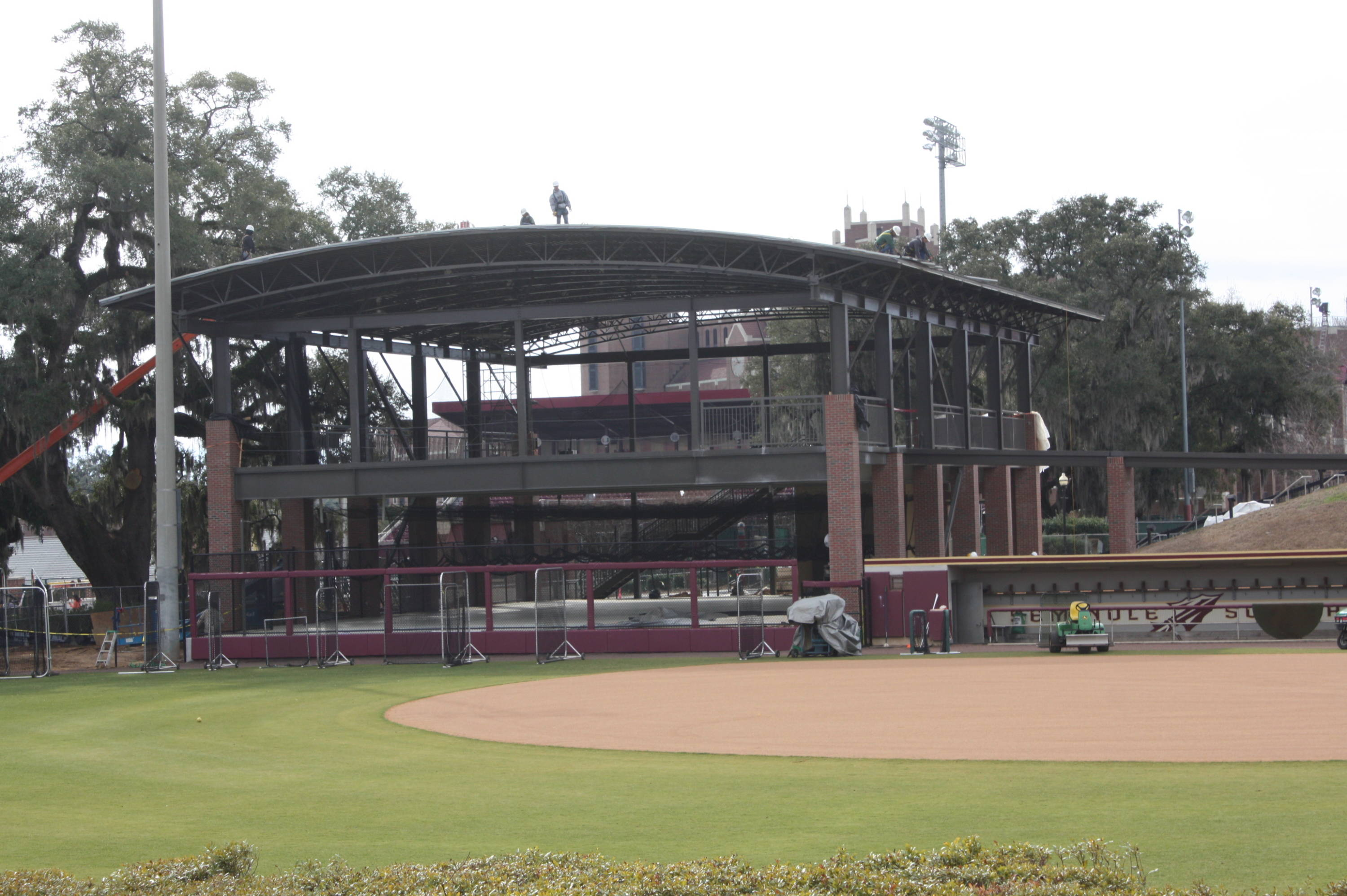 The indoor batting cage facility is now complete. Here is a picture of it near completion in early February