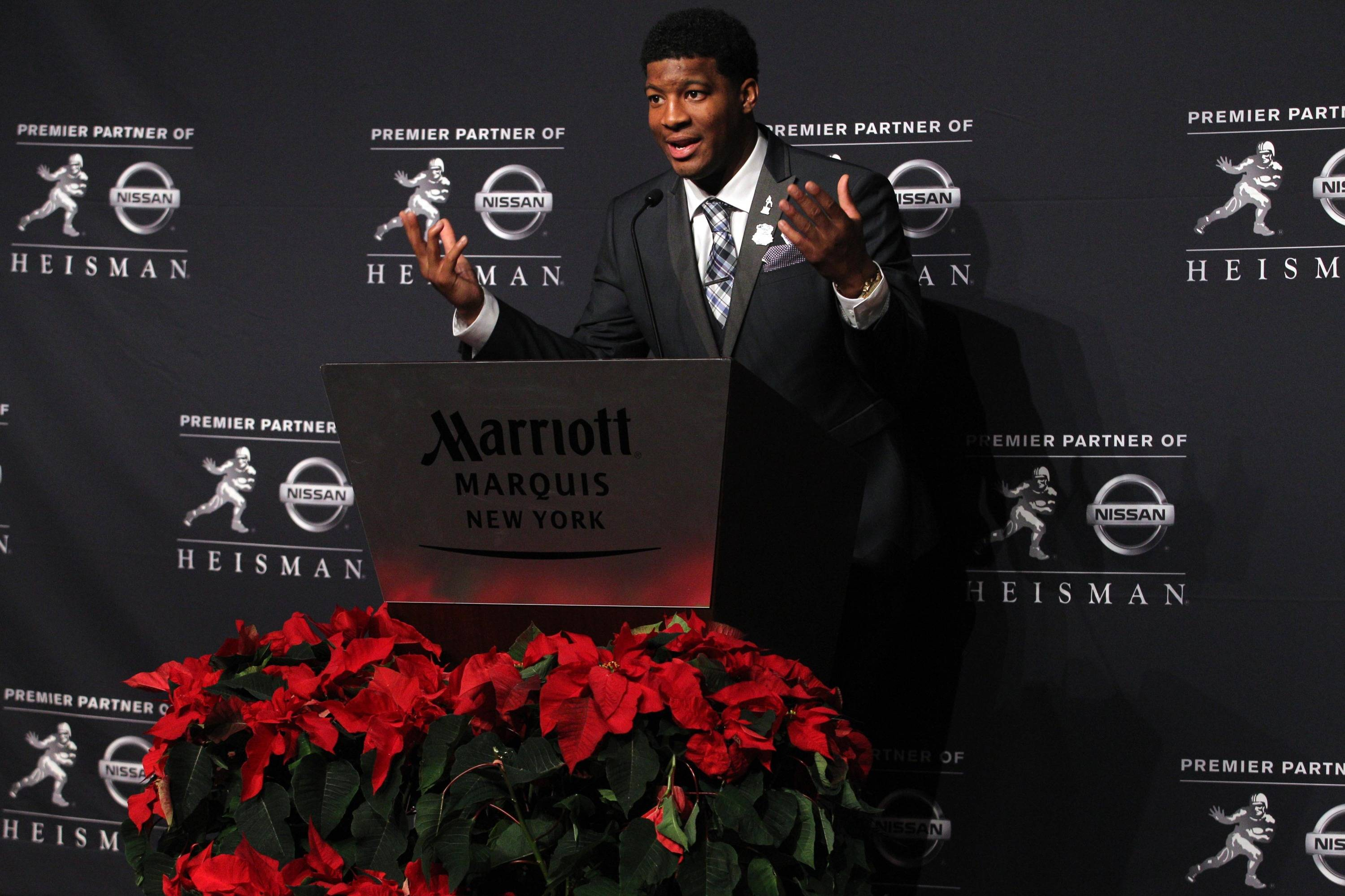 Dec 14, 2013; New York, NY, USA; Seminoles quarterback and 2013 Heisman Trophy winner Jameis Winston answers questions during a press conference. Brad Penner-USA TODAY Sports