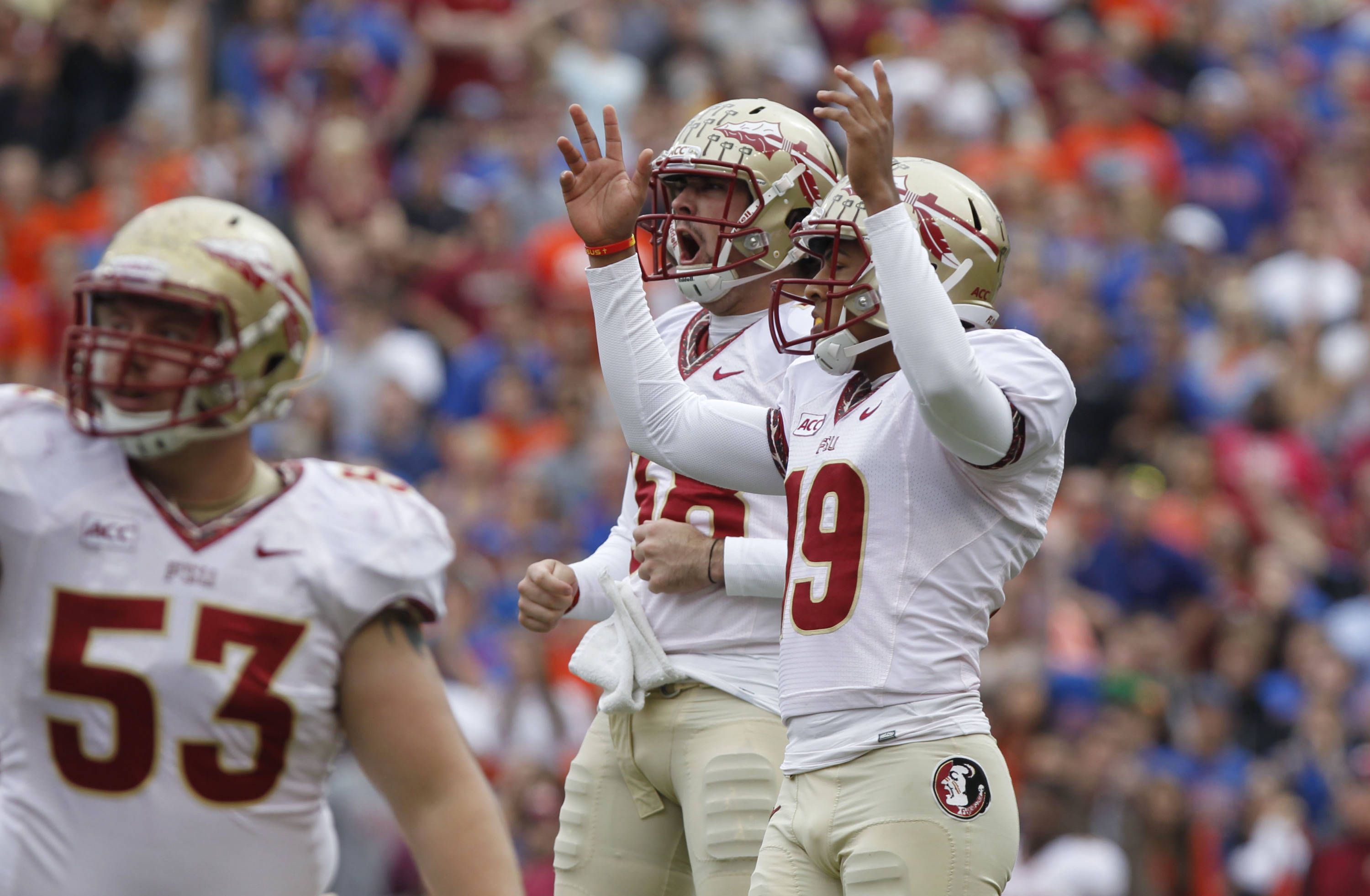 Roberto Aguayo (19) kicks a field goal as punter Cason Beatty (38) celebrates. Mandatory Credit: Kim Klement-USA TODAY Sports