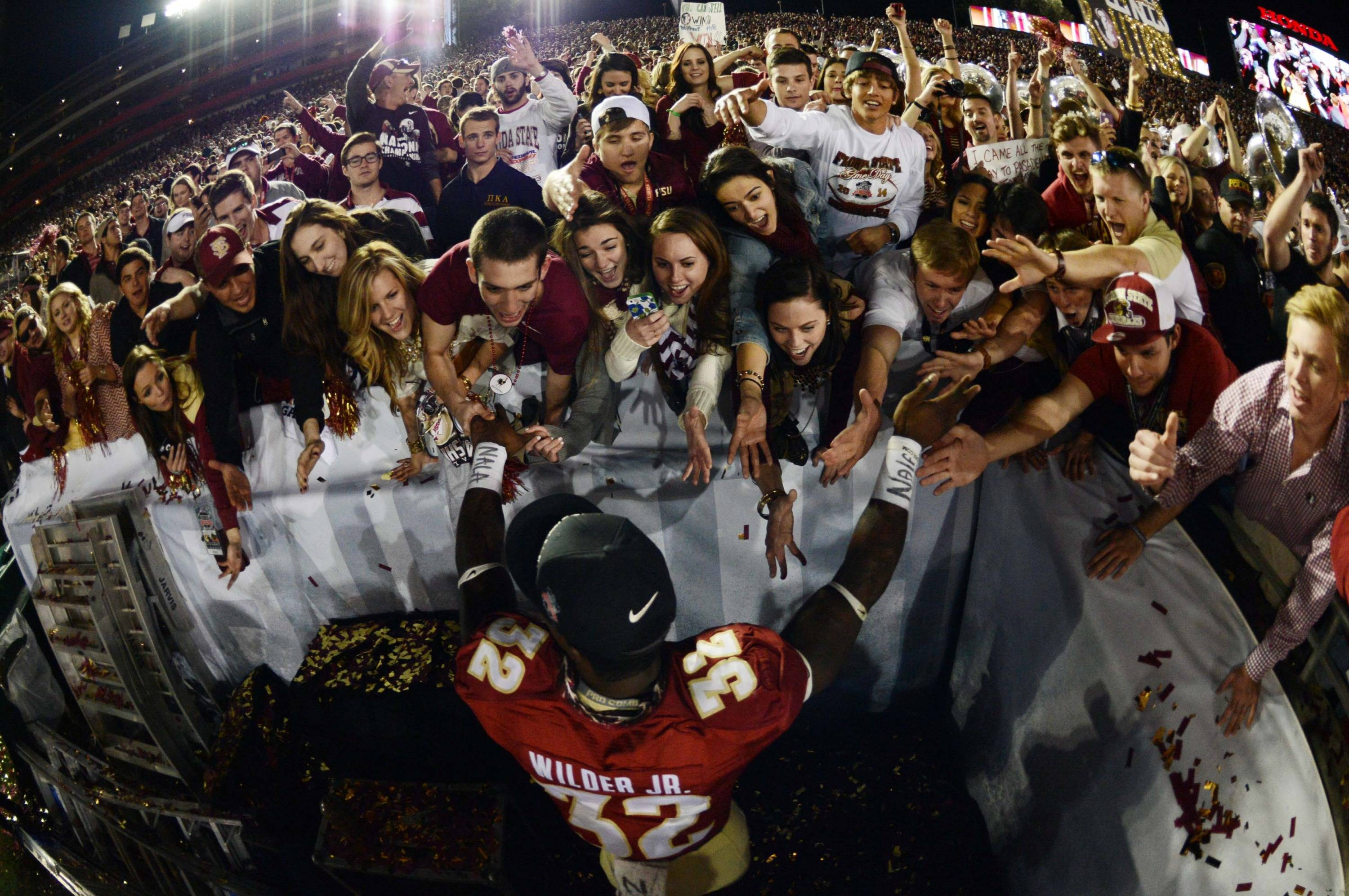 Jan 6, 2014; Pasadena, CA, USA; Florida State Seminoles running back James Wilder Jr. (32) celebrates with fans in the stands after the 2014 BCS National Championship game against the Auburn Tigers at the Rose Bowl.  Mandatory Credit: Jayne Kamin-Oncea-USA TODAY Sports