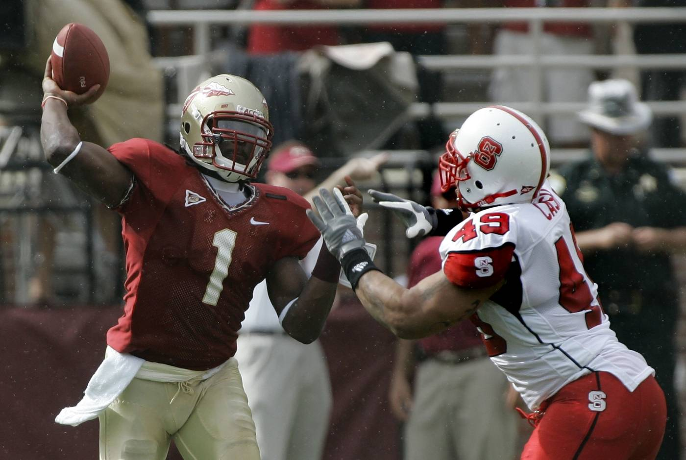 Florida State quarterback Xavier Lee, left, throws a second-quarter pass as North Carolina State's Alan-Michael Cash applies the pressure. (AP Photo/Phil Coale)