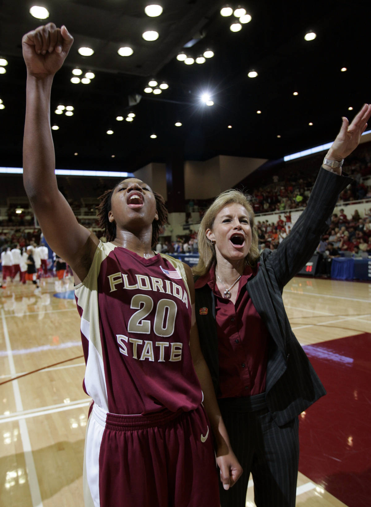 Florida State head coach Sue Semrau, right, and guard Tanae Davis-Cain (2) celebrate after defeating Old Dominion 85-75 in a first round NCAA West Regional women's basketball game Saturday, March 17, 2007, in Stanford, Calif. Davis-Cain was the game high scorer with 24 points. (AP Photo/Paul Sakuma)