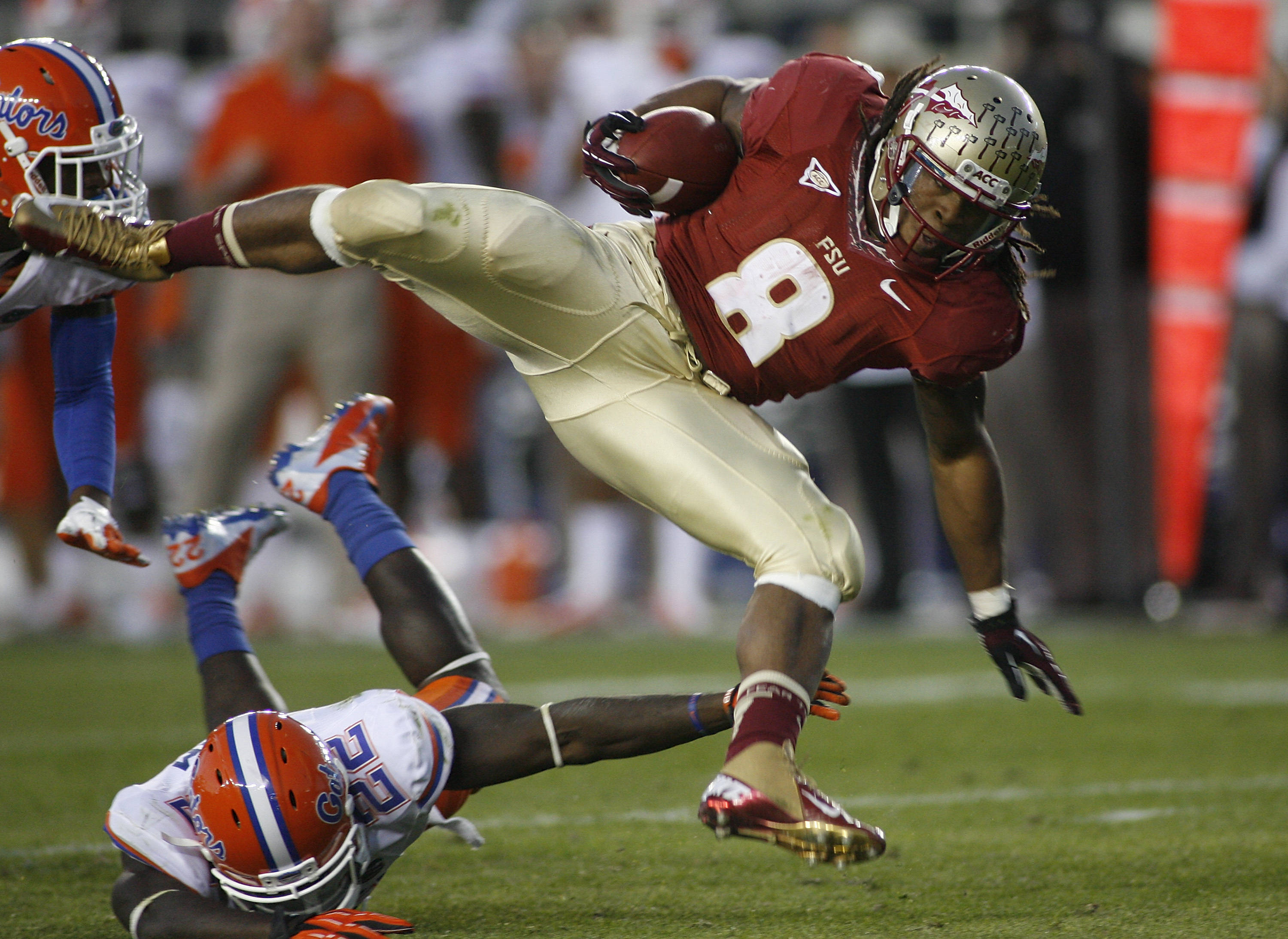 Florida State running back Devonta Freeman (8) goes airborne after he is hit by Florida defensive back Matt Elam (22). (AP Photo/Phil Sears)