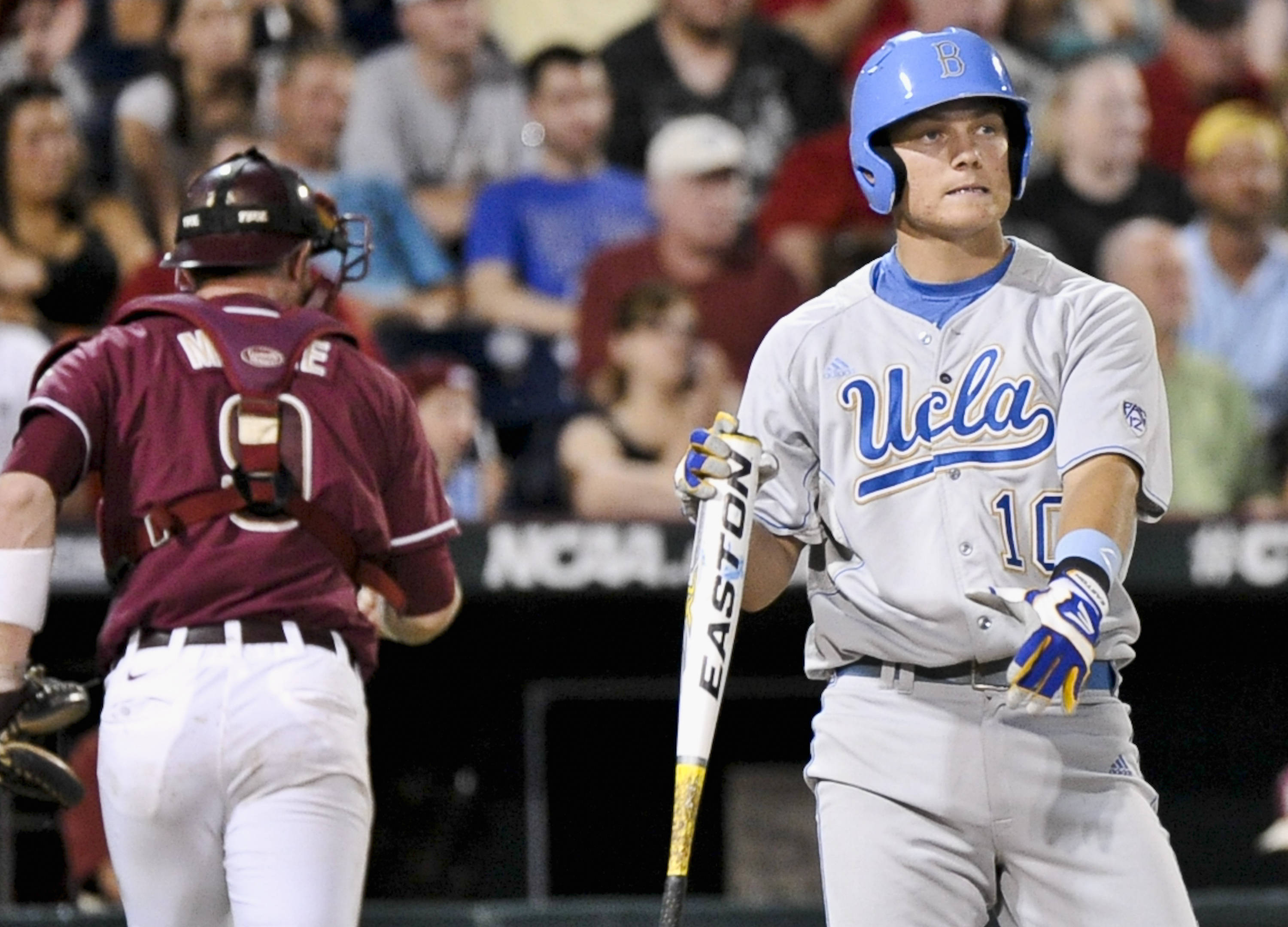 UCLA's Pat Valaika, right, reacts after Florida State pitcher Scott Sitz strikes him out to end the inning with bases loaded, in the sixth inning. (AP Photo/Ted Kirk)