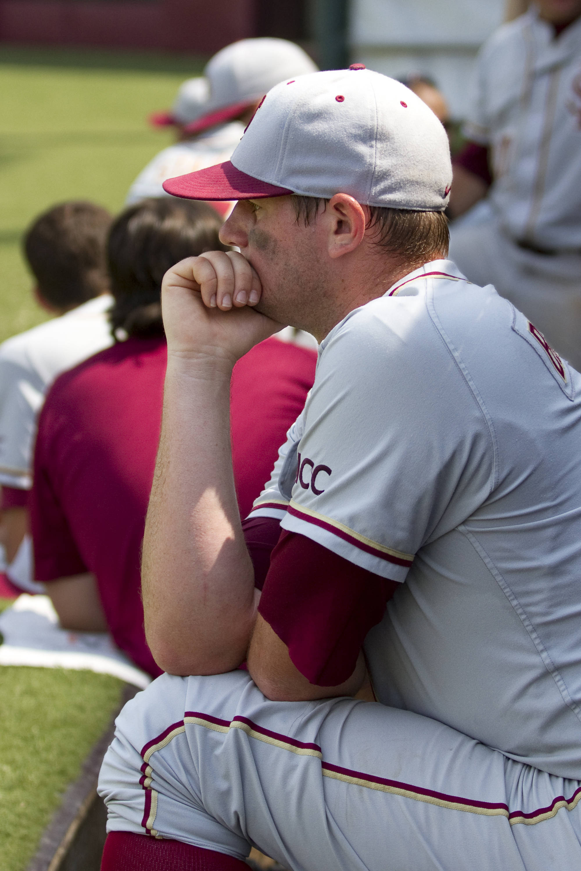 Brian Busch (24) watches the Seminoles try catch Vanderbilt in the top of the ninth inning.