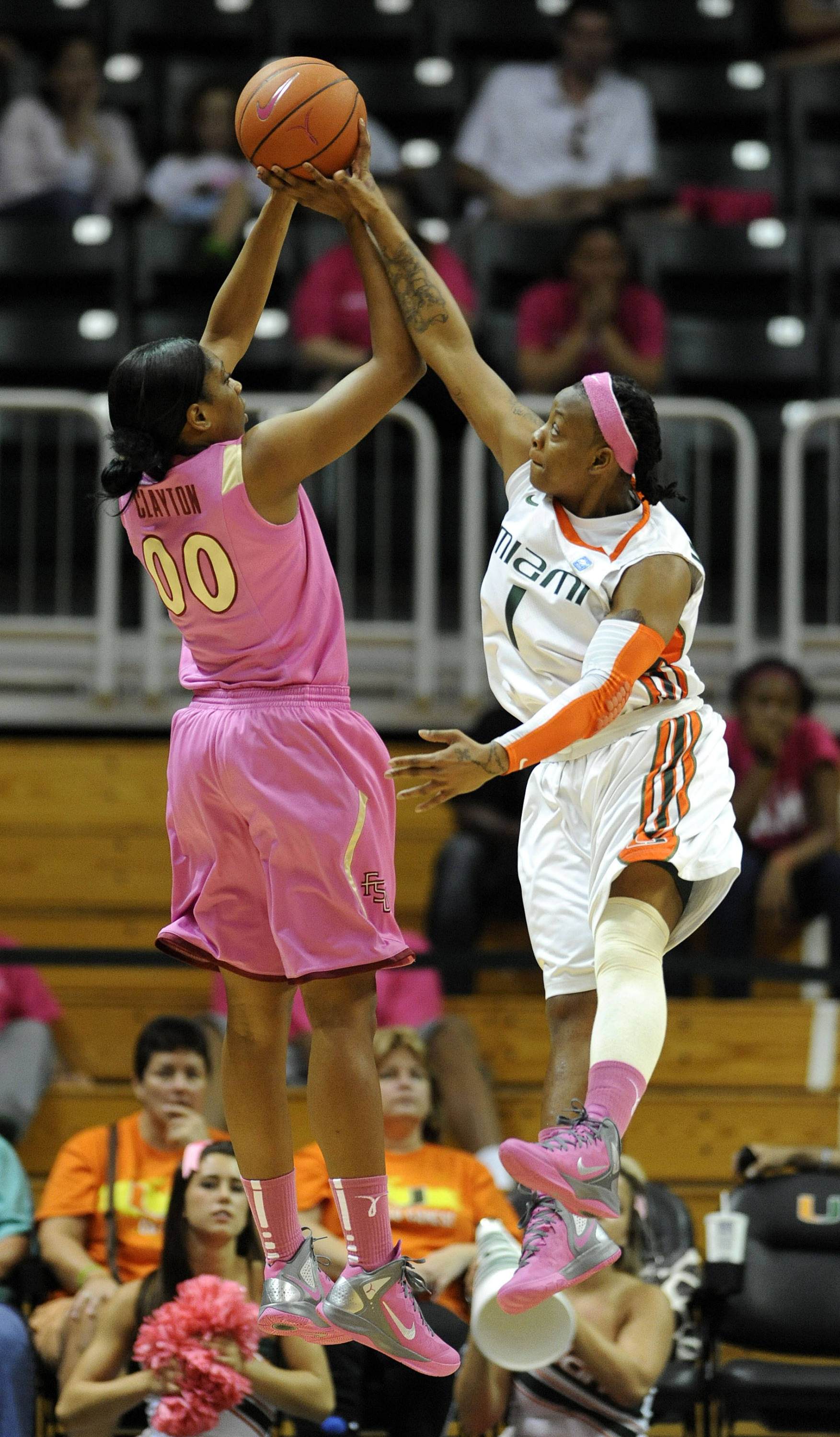 Miami's Riquna Williams, right, defends Florida State's Chasity Clayton, left, during the first half of an NCAA college basketball game on Sunday, Feb. 19, 2012 in Coral Gables, Fla. (AP Photo/Rhona Wise)
