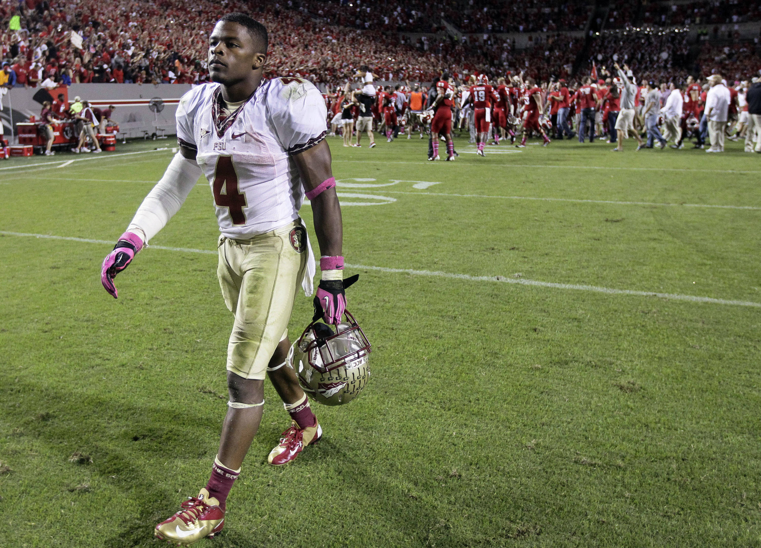 Florida State's Chris Thompson (4) walks off of the field following Florida State's 17-16 loss. (AP Photo/Gerry Broome)