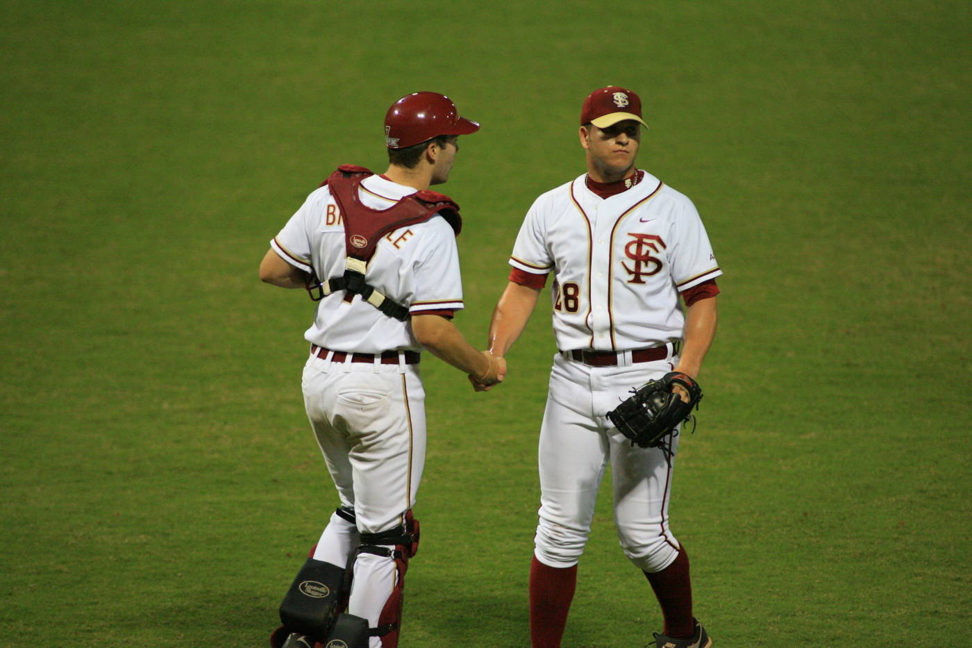 Parker Brunelle and Tyler Everett shake hands after wrapping up the game in the ninth inning