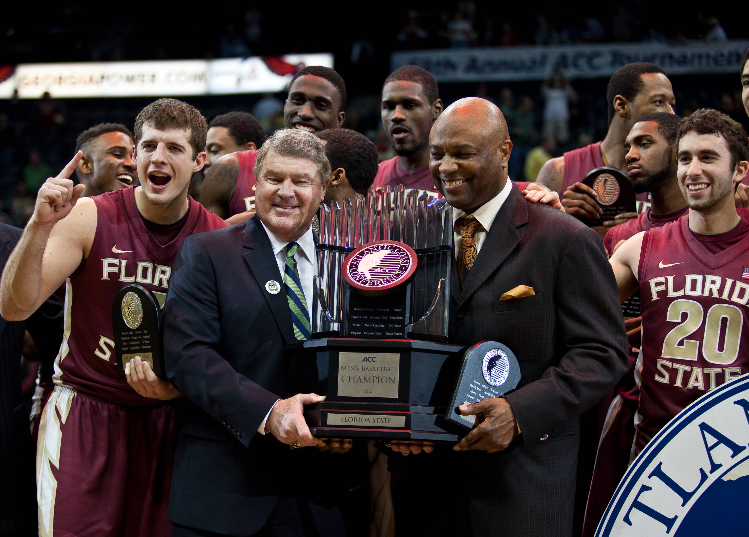 ACC Commissioner John Swofford with head coach Leonard Hamilton and the trophy