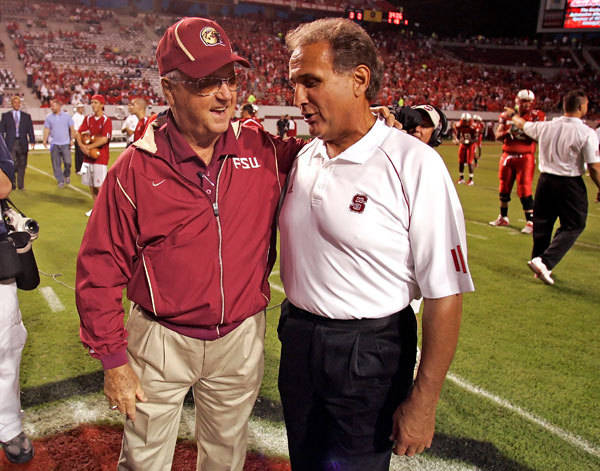Bobby Bowden and North Carolina State head coach Chuck Amato at midfield prior to the game. (AP Photo/Karl DeBlaker)