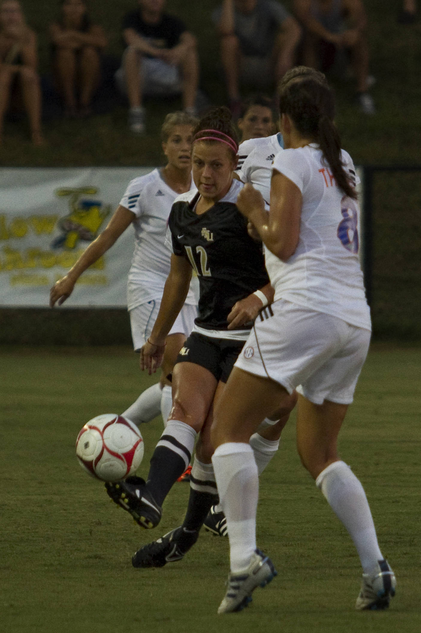 Breezy Hupp (12) passes around a UF defender.