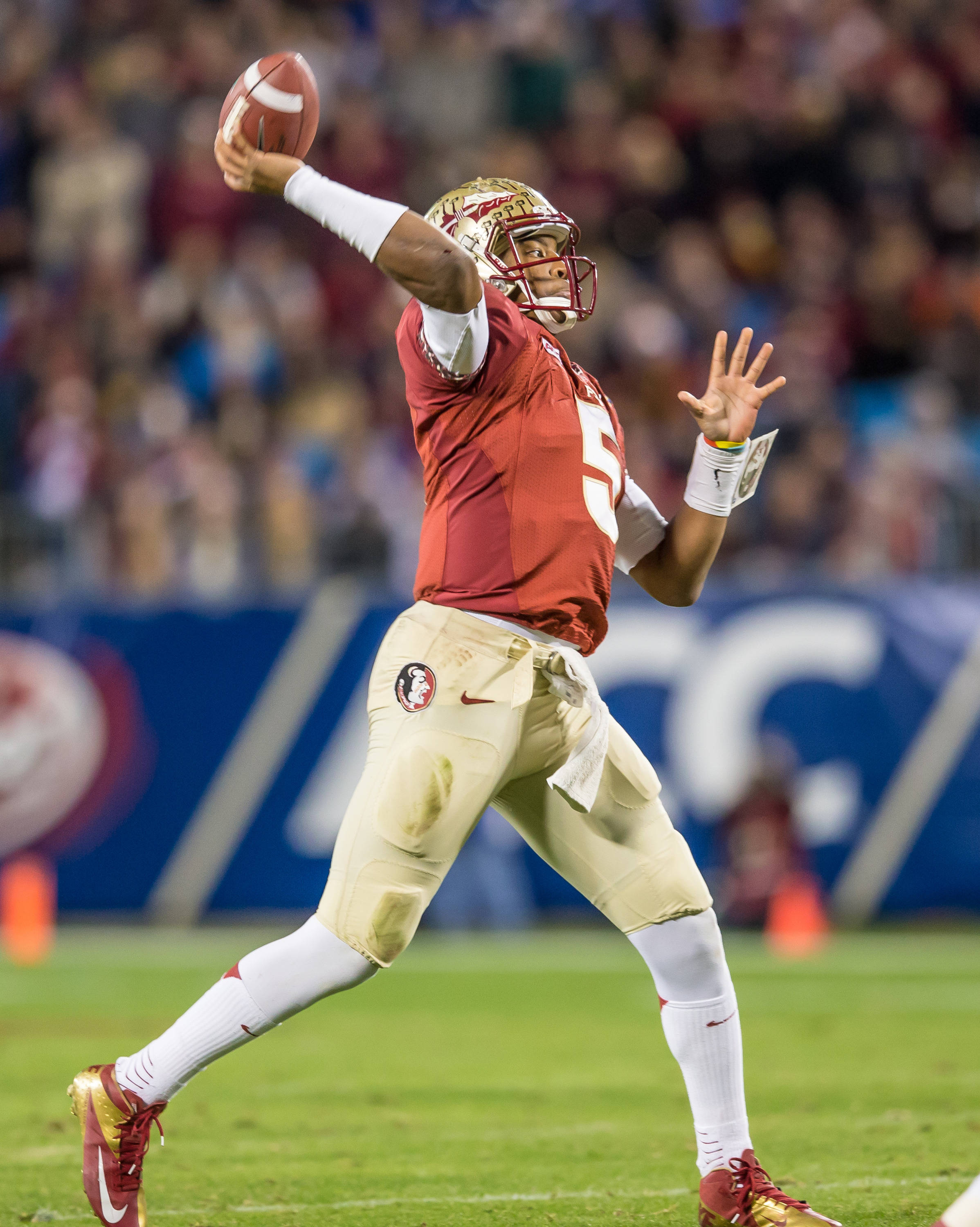 Jameis Winston (5) throws a 2nd quarter TD pass to Kelvin Benjamin.
