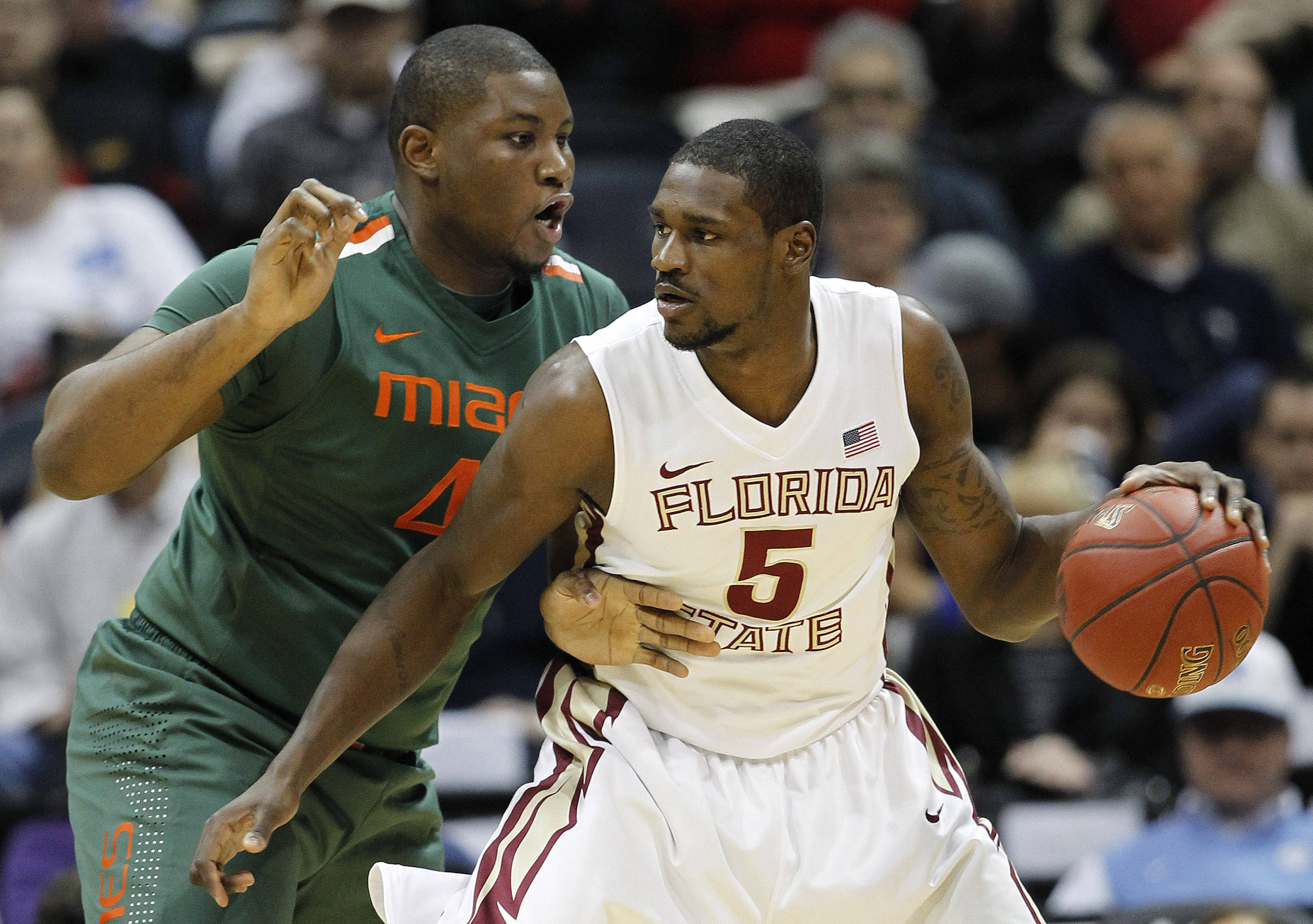Florida State forward Bernard James (5) works against Miami center Reggie Johnson (42) during the first half of an NCAA college basketball game in the quarterfinals of the Atlantic Coast Conference tournament, Friday, March 9, 2012, in Atlanta. (AP Photo/John Bazemore)