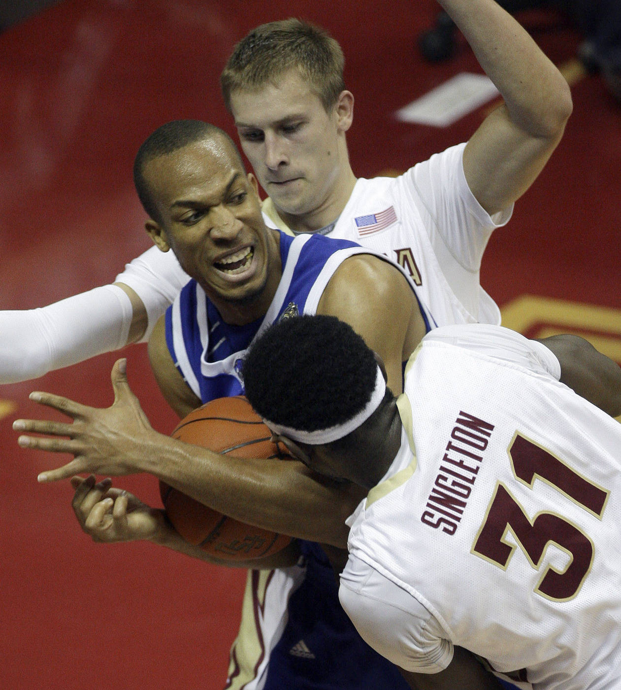 Georgia State's Kevin Lott, center, is double-teamed by Florida State's Chris Singleton, right, and Deividas Dulkys during the first half of an NCAA college basketball game, on Tuesday, Dec. 15, 2009, in Tallahassee, Fla.(AP Photo/Phil coale)