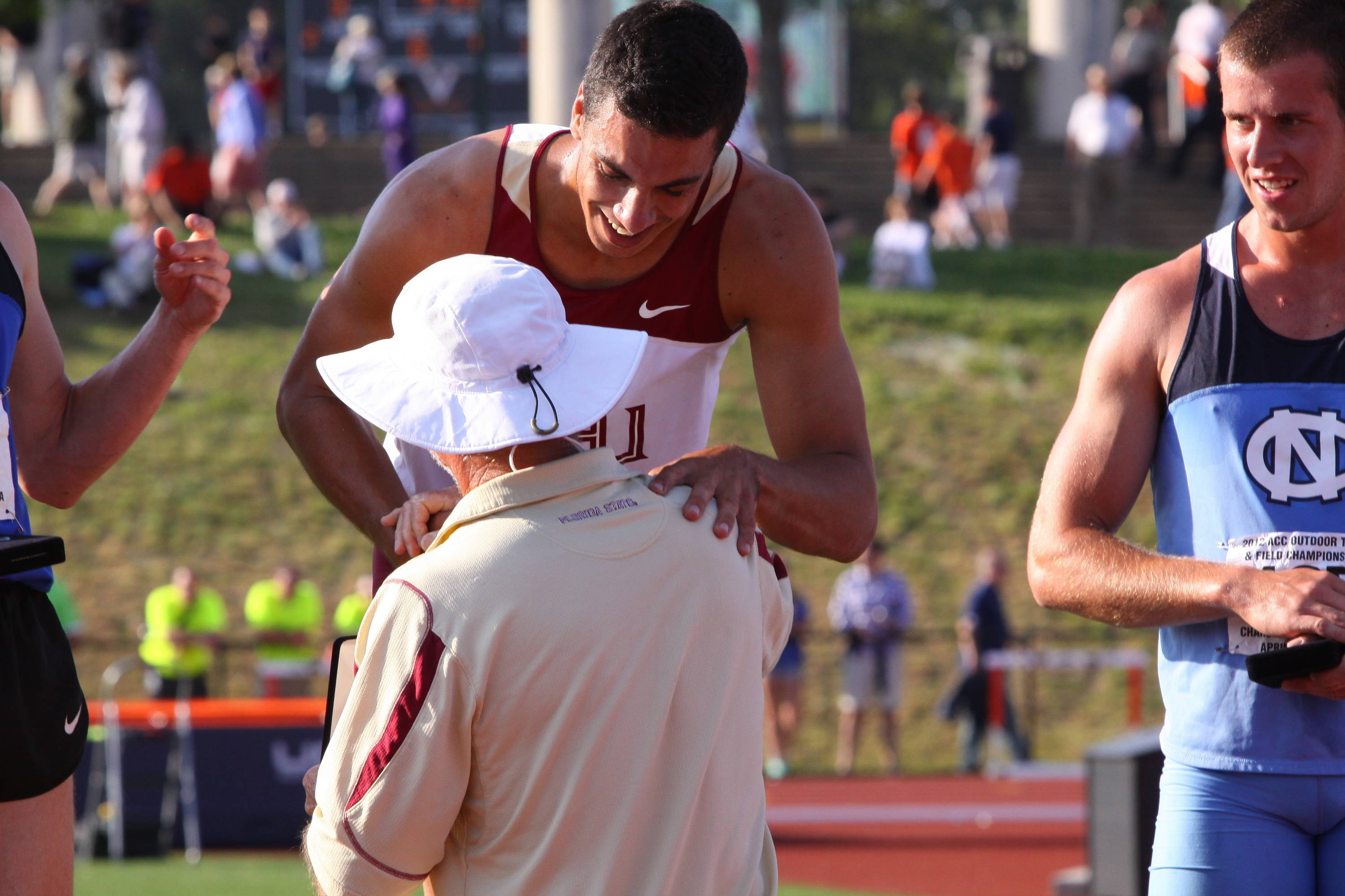 FSU coach Dennis Nobles presented Barroilhet his gold medal on the podium...