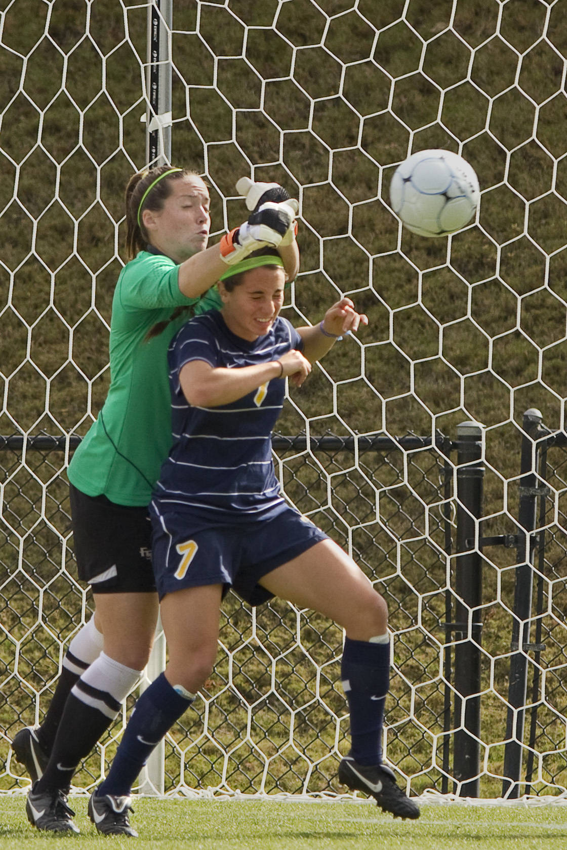 FSU's keeper reaches over a Marquette offender to make a save.