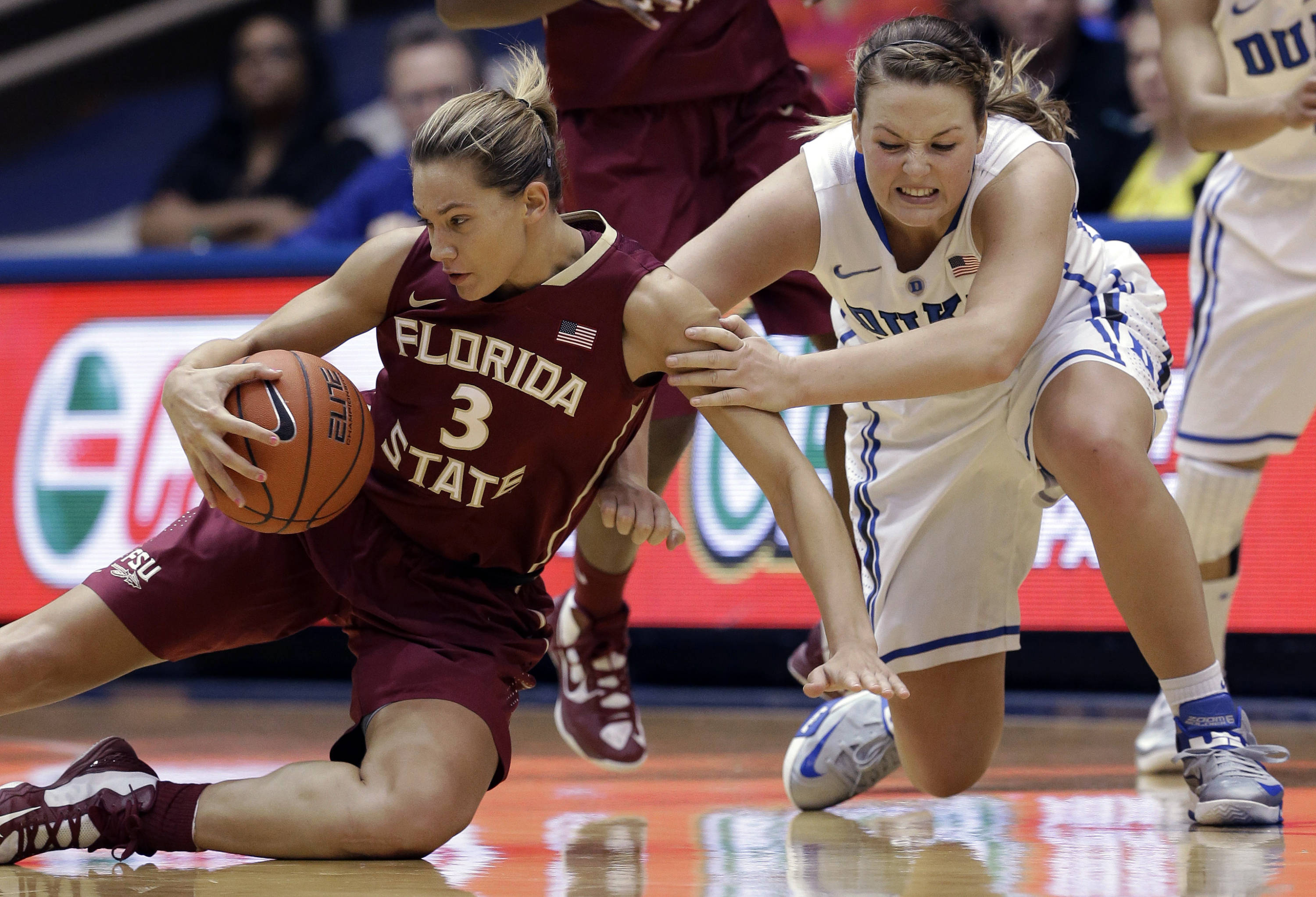 Duke's Tricia Liston, right, and Florida State's Alexa Deluzio (3) struggle for possession of the ball during the second half. (AP Photo/Gerry Broome)
