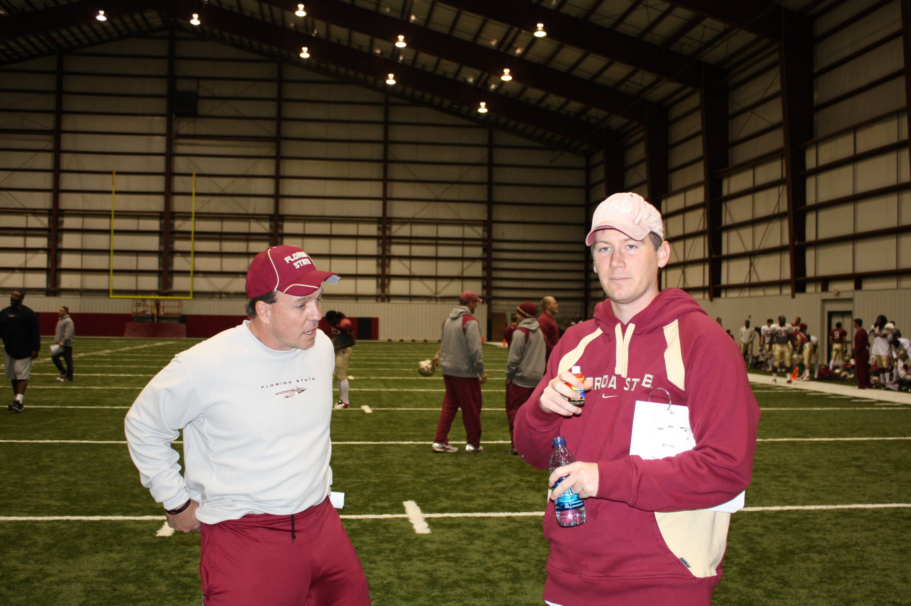 Jimbo Fisher and offensive GA Travis Trickett discuss practice.