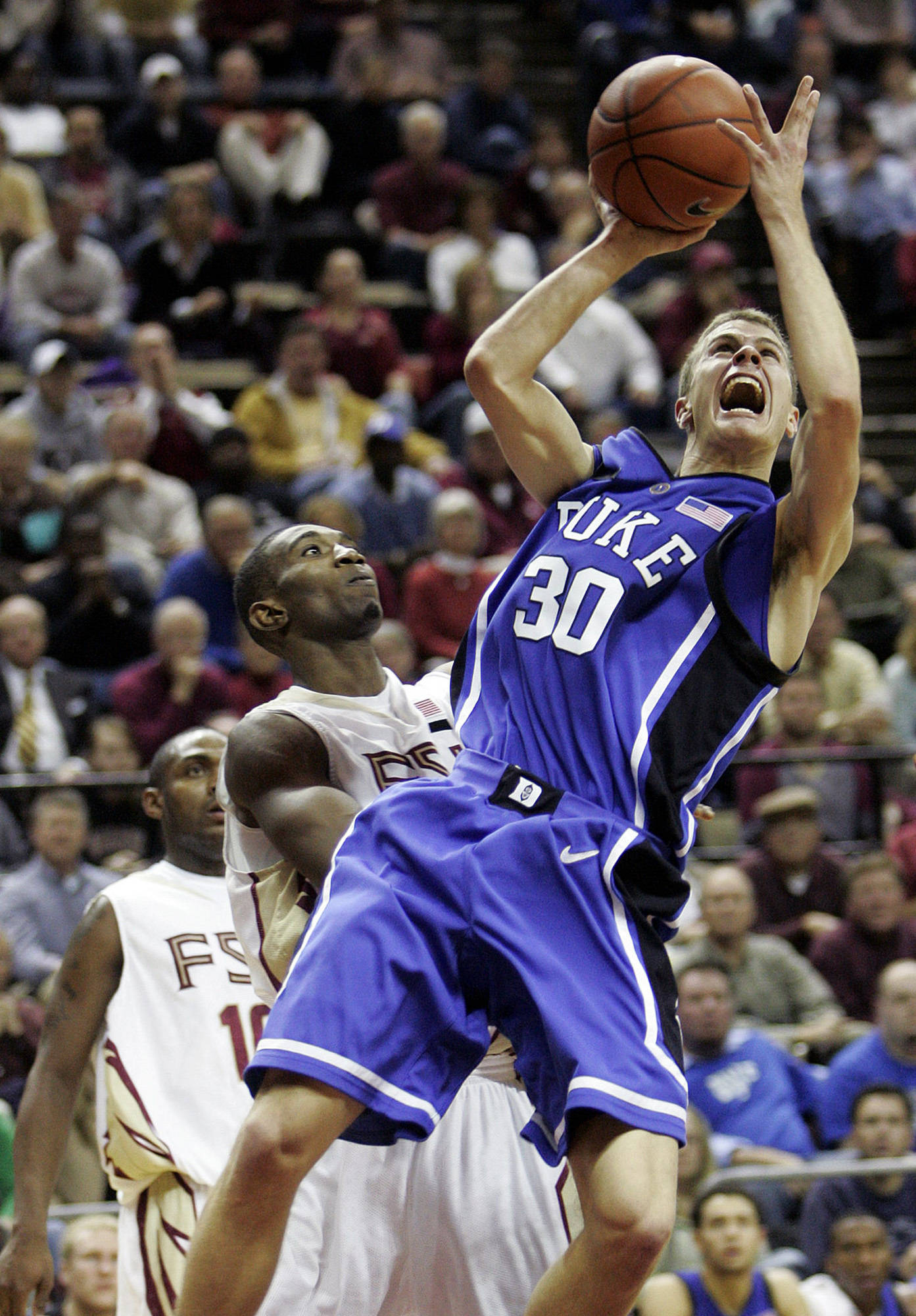 Duke's Jon Scheyer is fouled by Florida State's Uche Echefu as he scores and completed the three point play in the second half of a college basketball game, which Duke won 70-57 on Wednesday, Jan. 16, 2008 in Tallahassee, Fla.