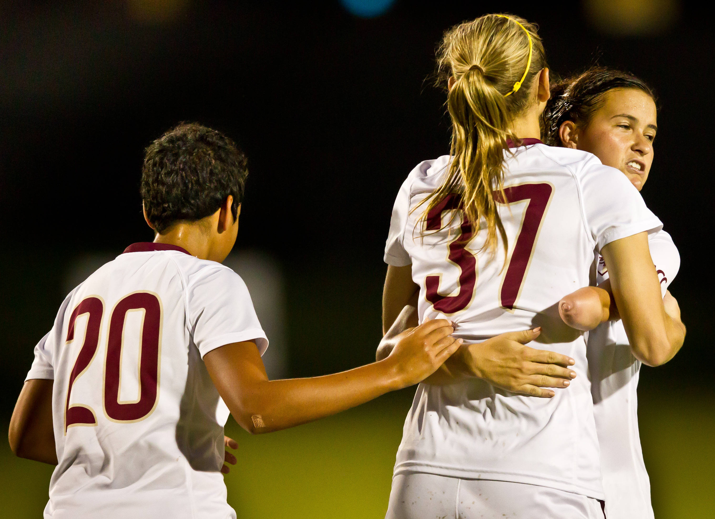 Carson Pickett (16) and Anna McClung (37) celebrate the Noles 3rd goal versus Miami.#$%^#$%^Photo by Ross Obley