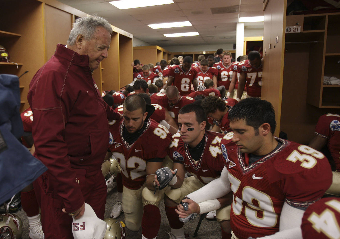 Florida State head coach, Bobby Bowden delivers a prayer in the locker room prior to the start of the Gator Bowl NCAA college football game against West Virginia, on Friday, Jan. 1, 2010, in Jacksonville, Fla.(AP Photo/Phil Coale)