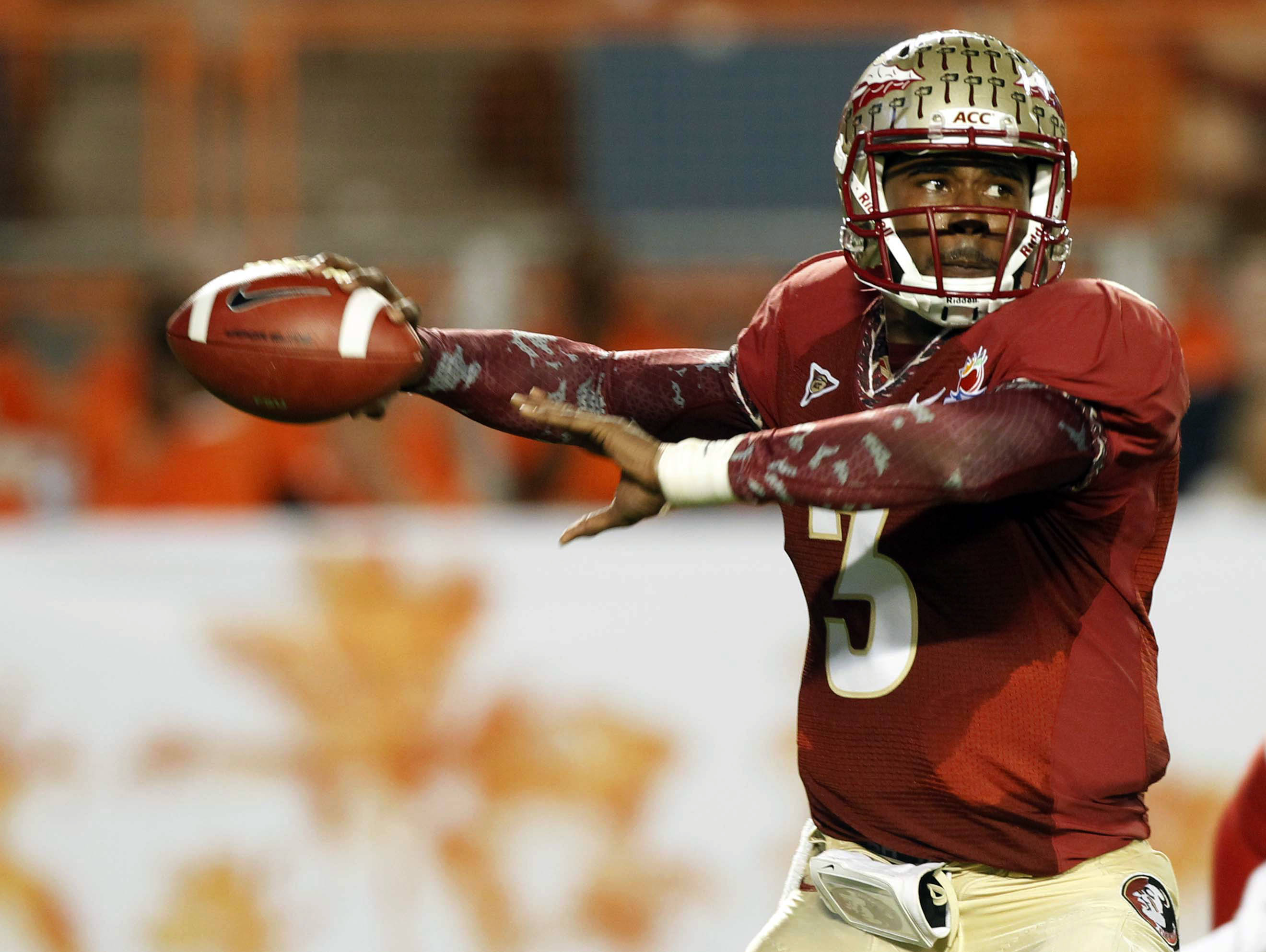 Florida State quarterback EJ Manuel (3) looks to pass during the first half of the Orange Bowl NCAA college football game against Northern Illinois, Tuesday, Jan. 1, 2013, in Miami. (AP Photo/Alan Diaz)