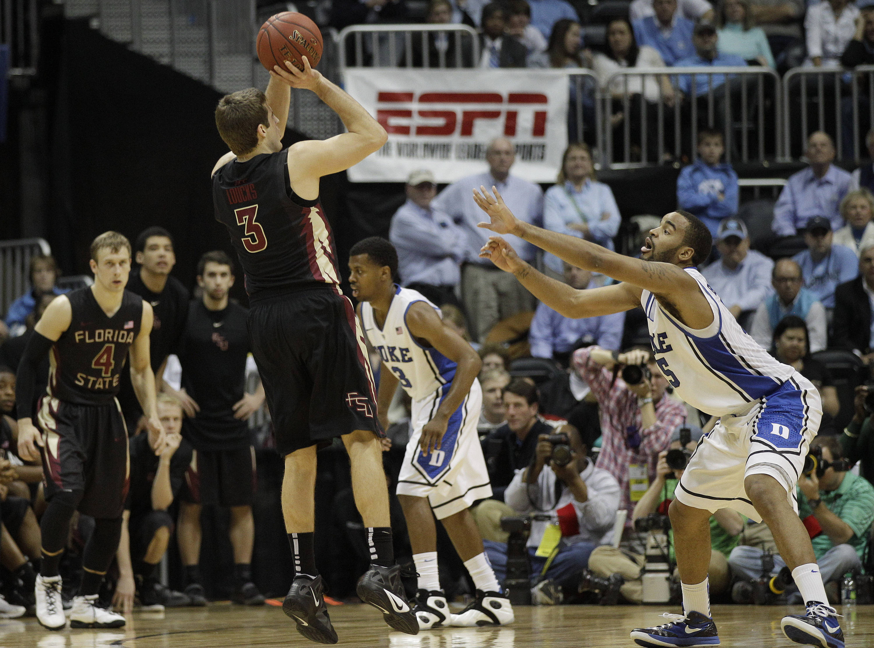 Florida State guard Luke Loucks (3) shoots over Duke forward Josh Hairston (15) late in the second half of of an NCAA college basketball game in the semifinals of the Atlantic Coast Conference tournament, Saturday, March 10, 2012, in Atlanta. Florida State won 62-59. (AP Photo/Chuck Burton)
