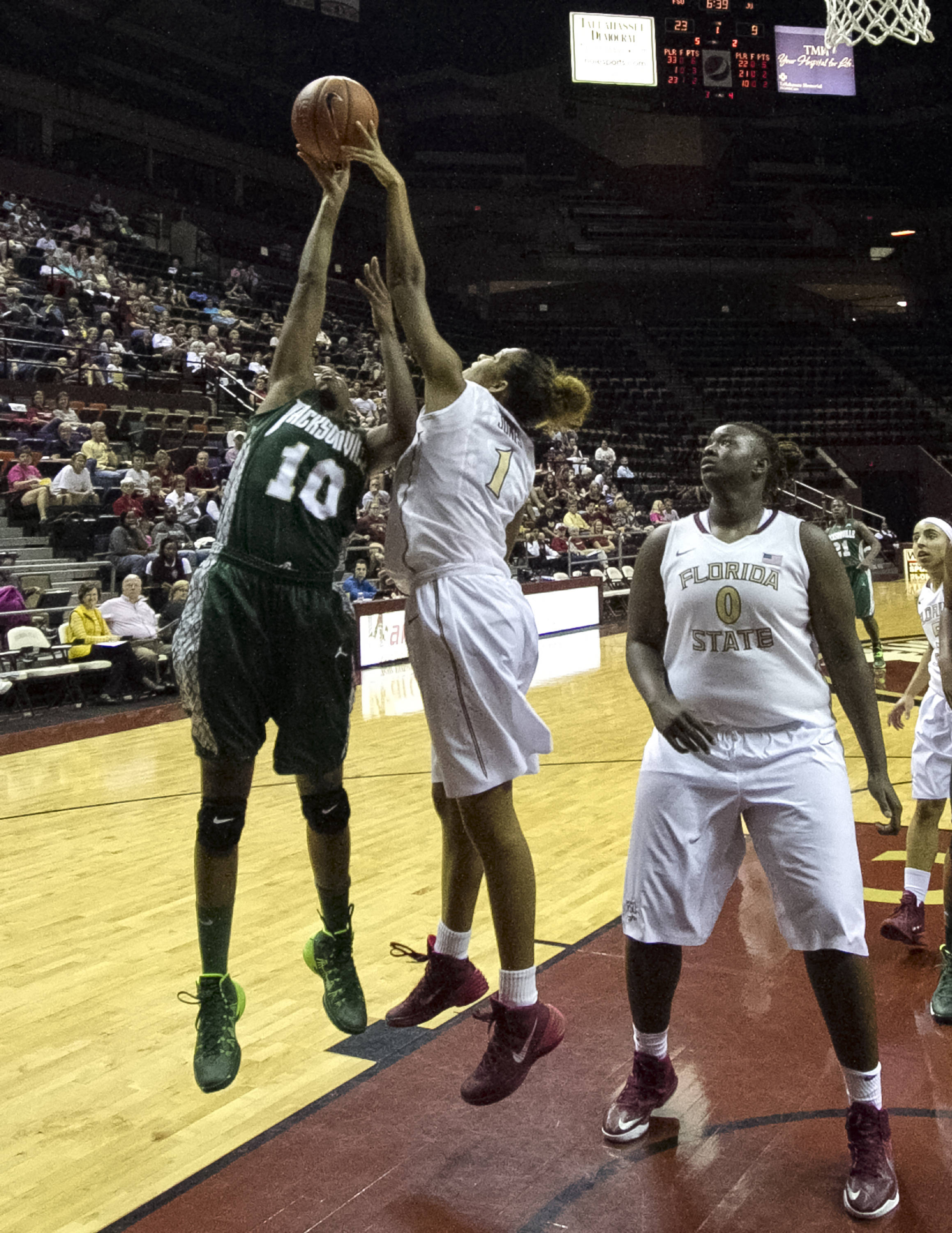 Morgan Jones (1),  with a block, FSU vs Jacksonville, 12-08-13,  (Photo by Steve Musco)