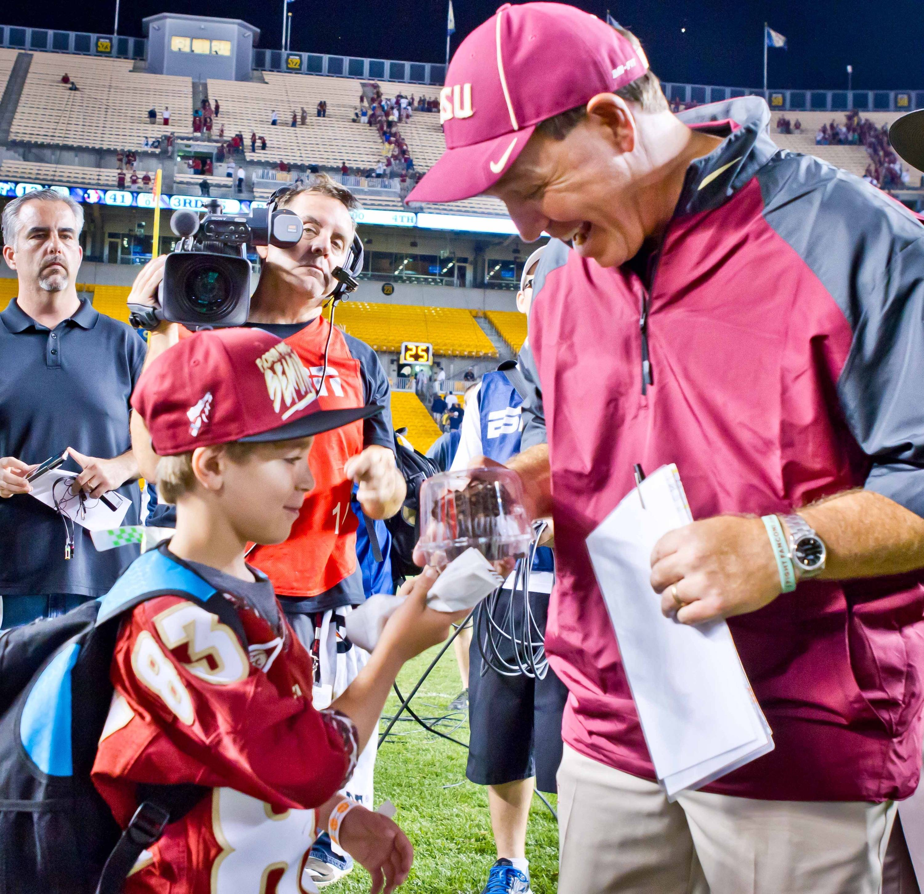 Jimbo Fisher receives a gift from his son, Ethan.