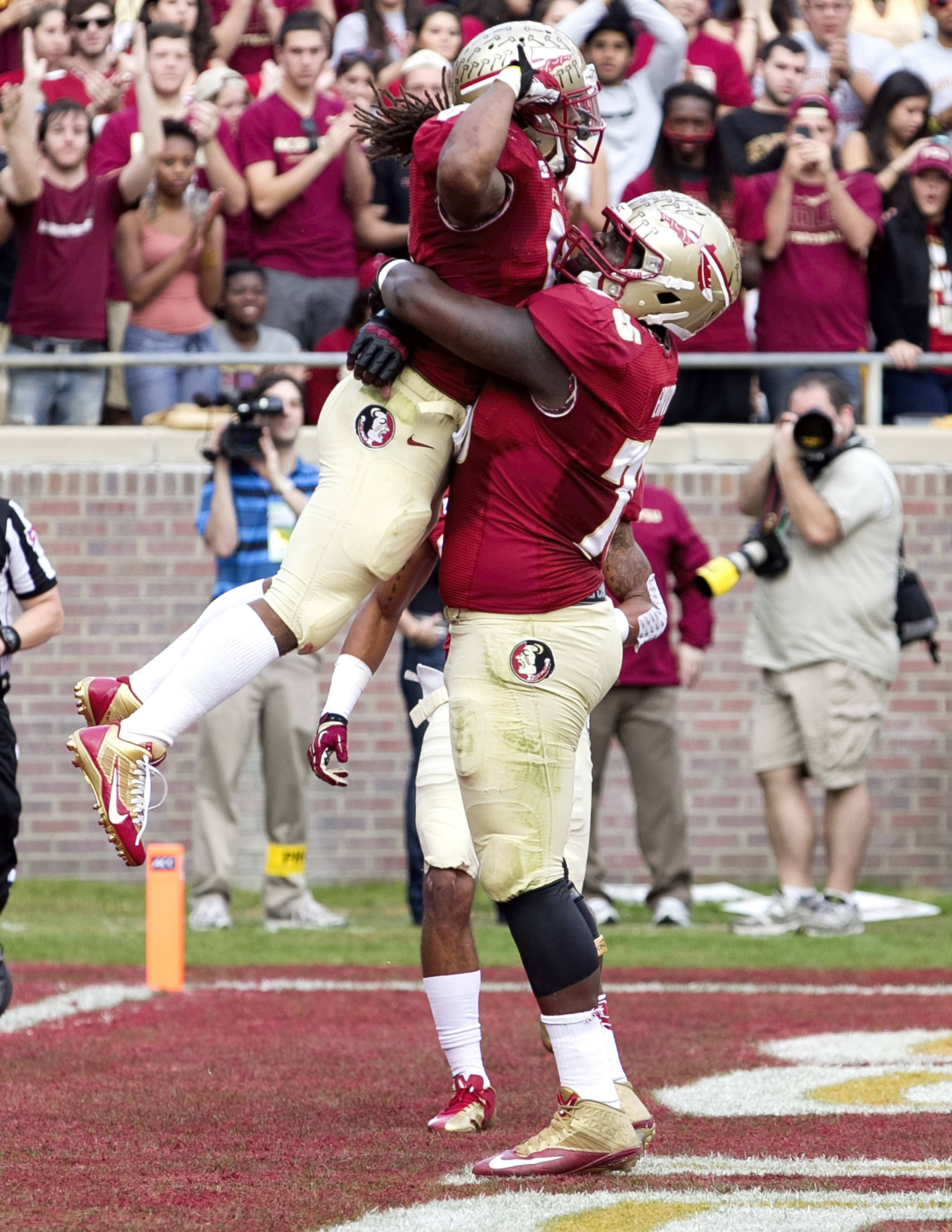 Cameron Erving (75) holding up Devonta Freeman (8) after his score. FSU vs Syracuse, 11-16-13, (Photo by Steve Musco)