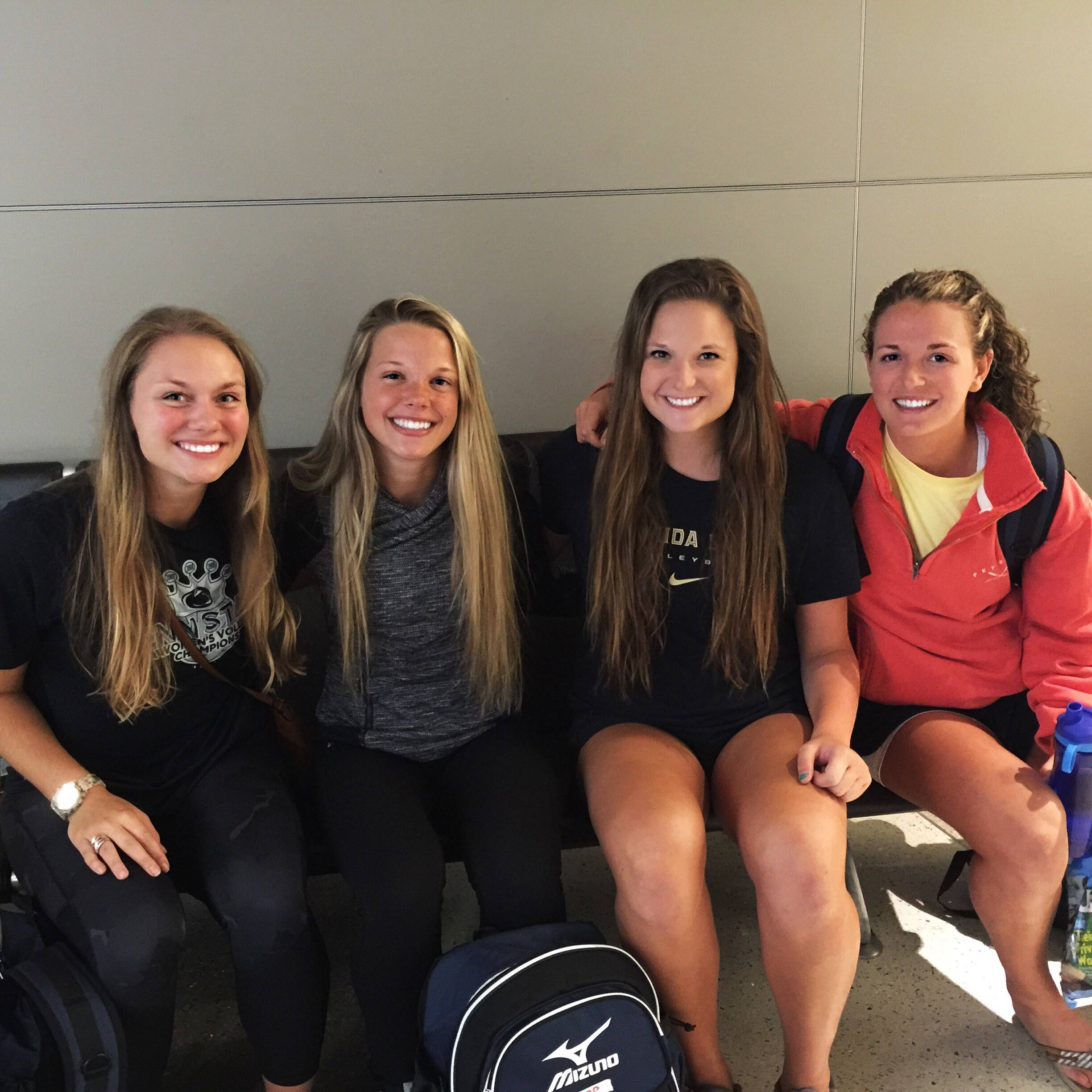 Nicole Walch smiles with some of her teammates.
