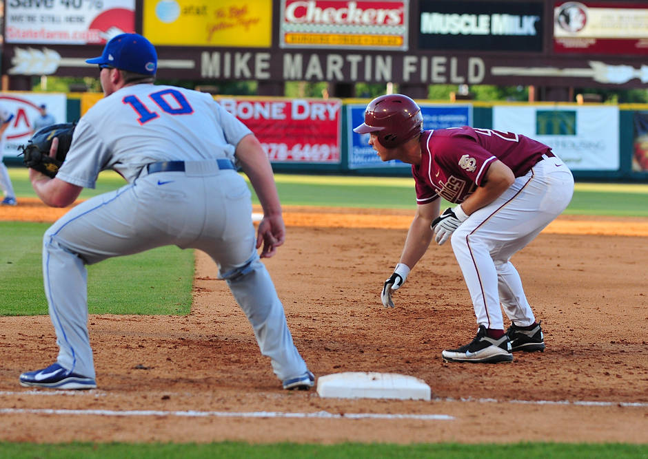 Seminoles' slugger Mike McGee gets a lead at first in the early going against Florida in Tuesday's 3-1 victory.