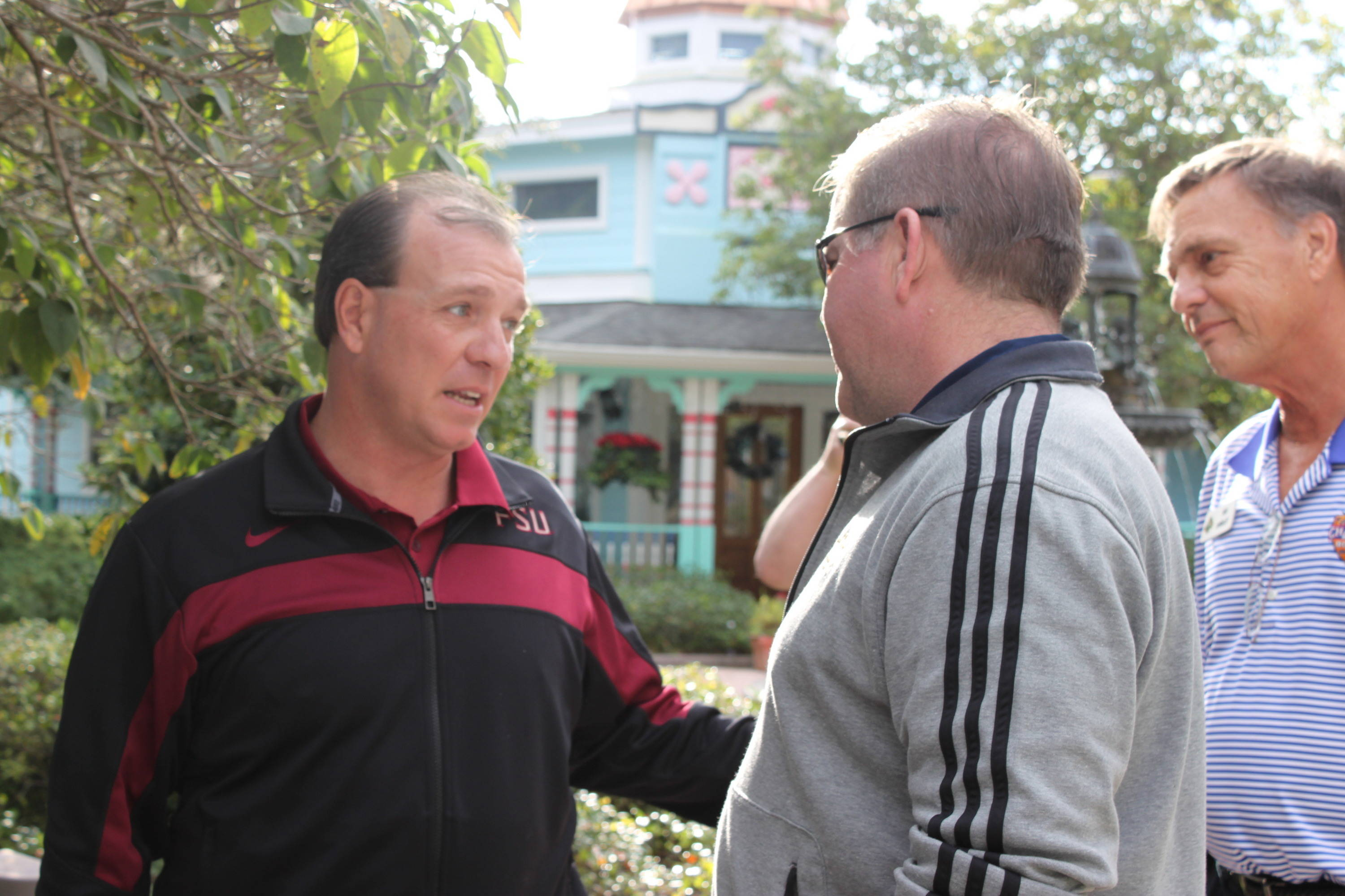 FSU coach Jimbo Fisher shares a word with his Notre Dame counterpart Brian Kelly at the park.