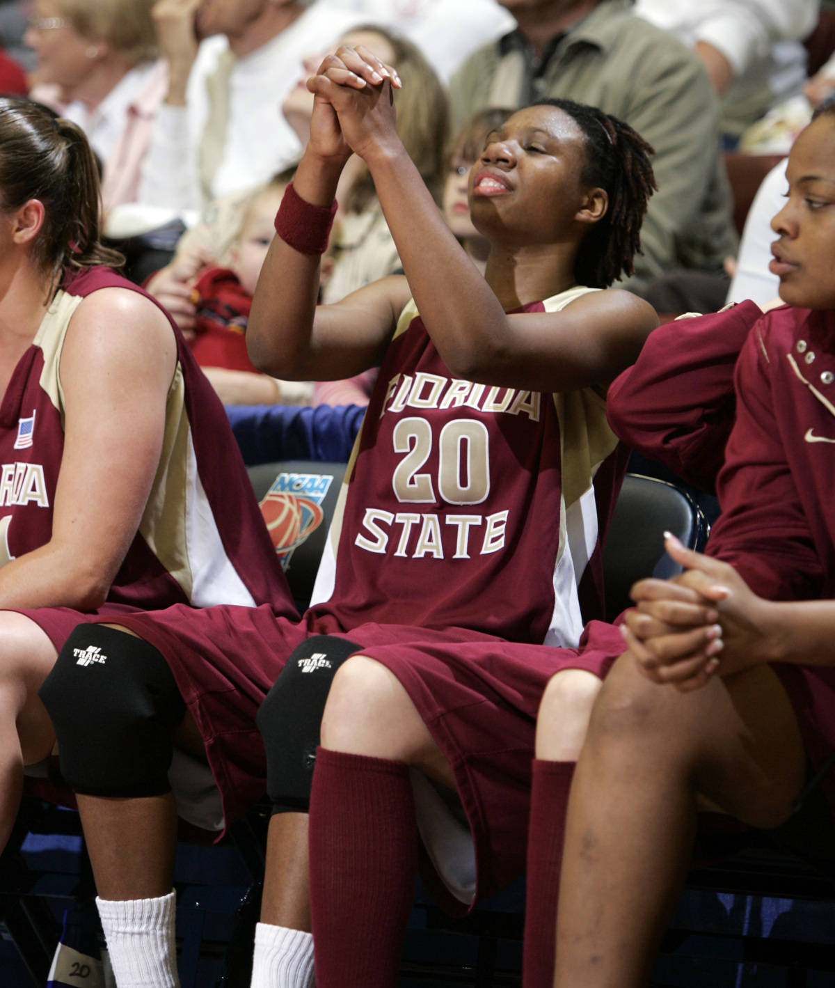 Florida State guard Tanae Davis-Cain holds her hands together while on the bench in the final minutes of the second half against Stanford during their second-round game in the NCAA women's basketball tournament in Stanford, Calif., Monday, March 19, 2007. Florida State upset Stanford 68-61. (AP Photo/Paul Sakuma)