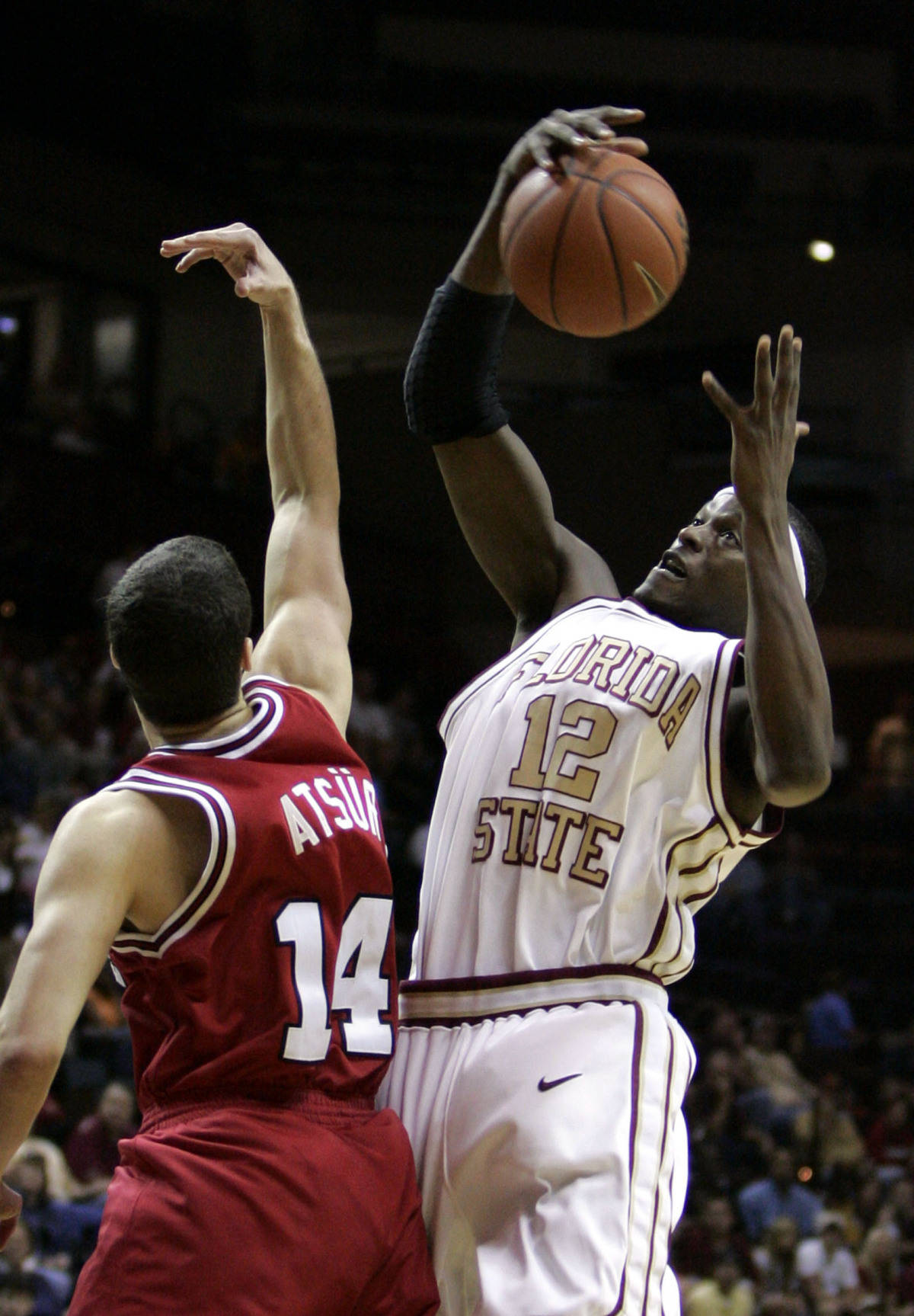 Florida State's Al Thornton (12) pulls down a first-half rebound against North Carolina State's Engin Atsur (14) during a college basketball game, Saturday, Feb. 24, 2007, in Tallahassee, Fla. Thornton, in his last home game, led the Seminoles with 17 points in their 78-52 win. (AP Photo/Brandon Goodman)